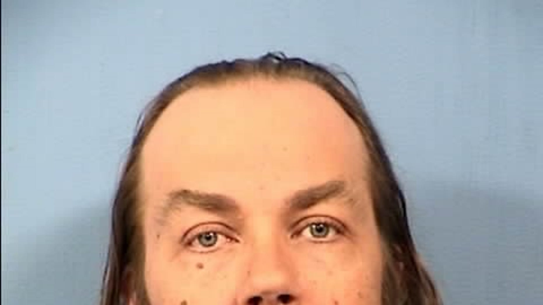 Thomas Spear, 43, was charged in the 1994 killing of a 71-year-old woman.