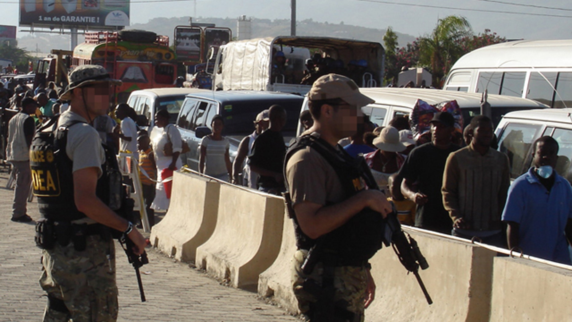Special agents help protect U.S. Embassy in Port-au-Prince, Haiti.