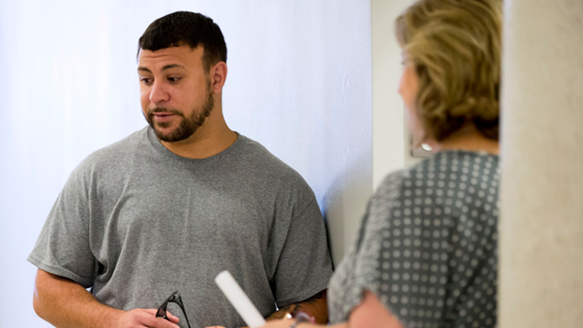 Aug. 21, 2013: This photo shows Iraqi war veteran Paul Piscicelli, left, speaking with Peg Maynard, veterans justice outreach specialist for the Department of Veterans Affairs, at the justice center in Philadelphia.