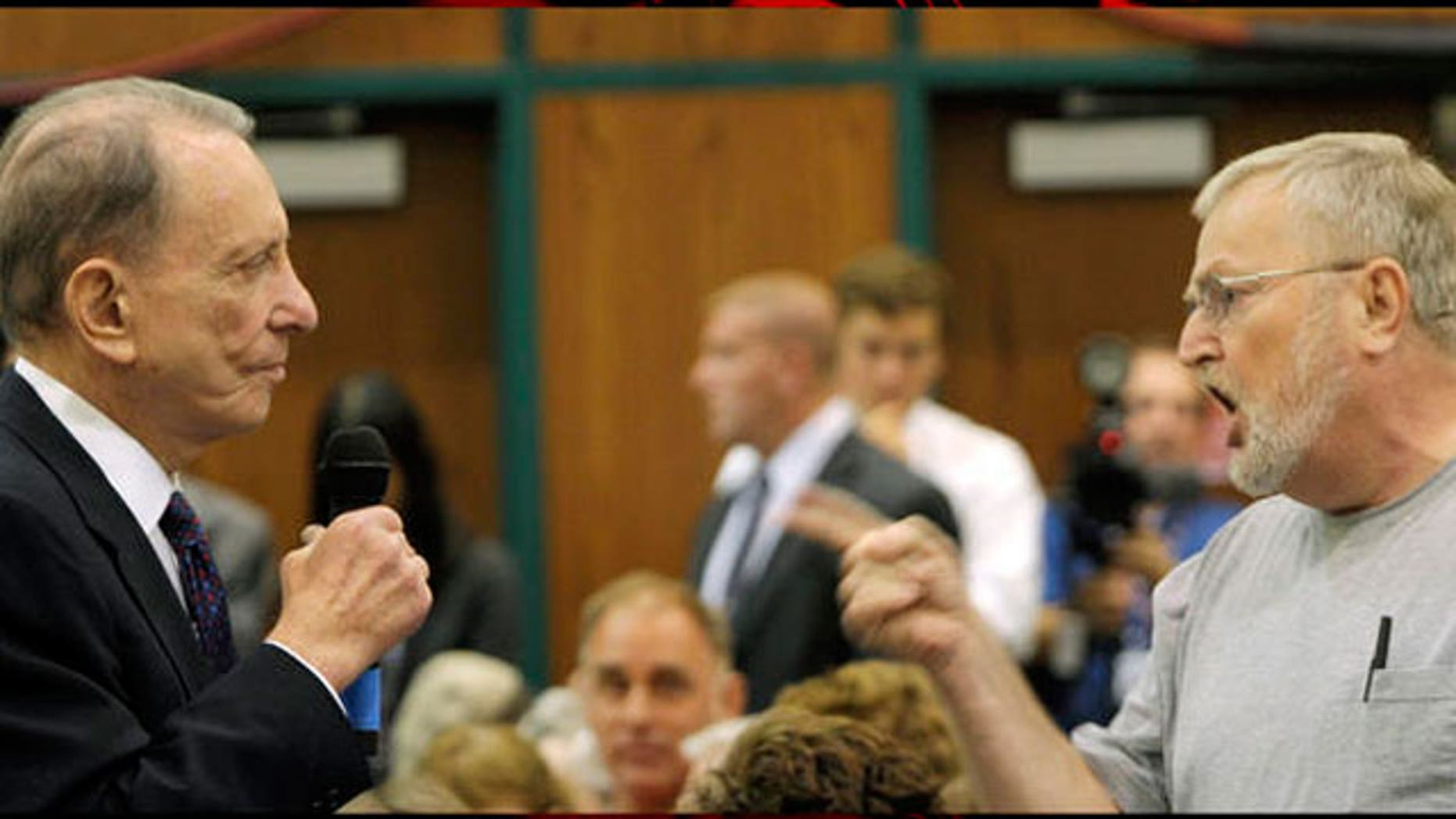 An angry constituent confronts Sen. Arlen Specter at a town hall-style meeting on health care, August, 11, 2009. (AP)
