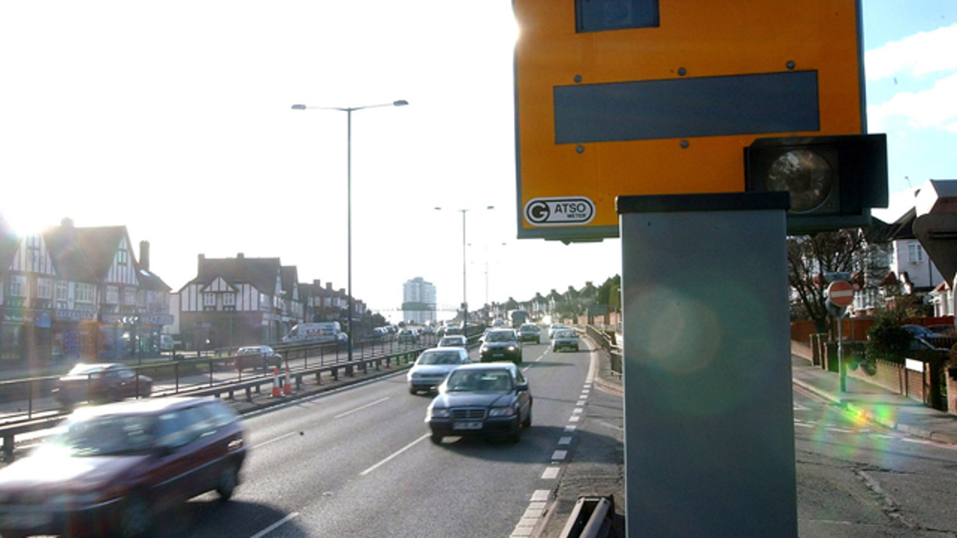 A speed camera watches over a highway in England.