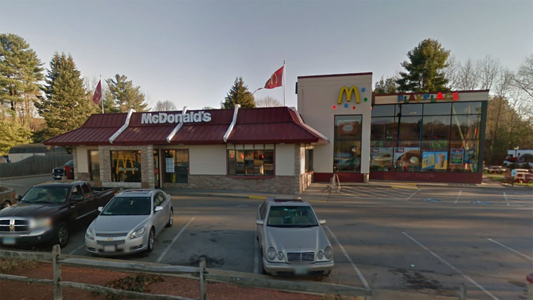 Firefighters responded to McDonald's in Massachusetts after a young girl became stuck in the playground equipment.