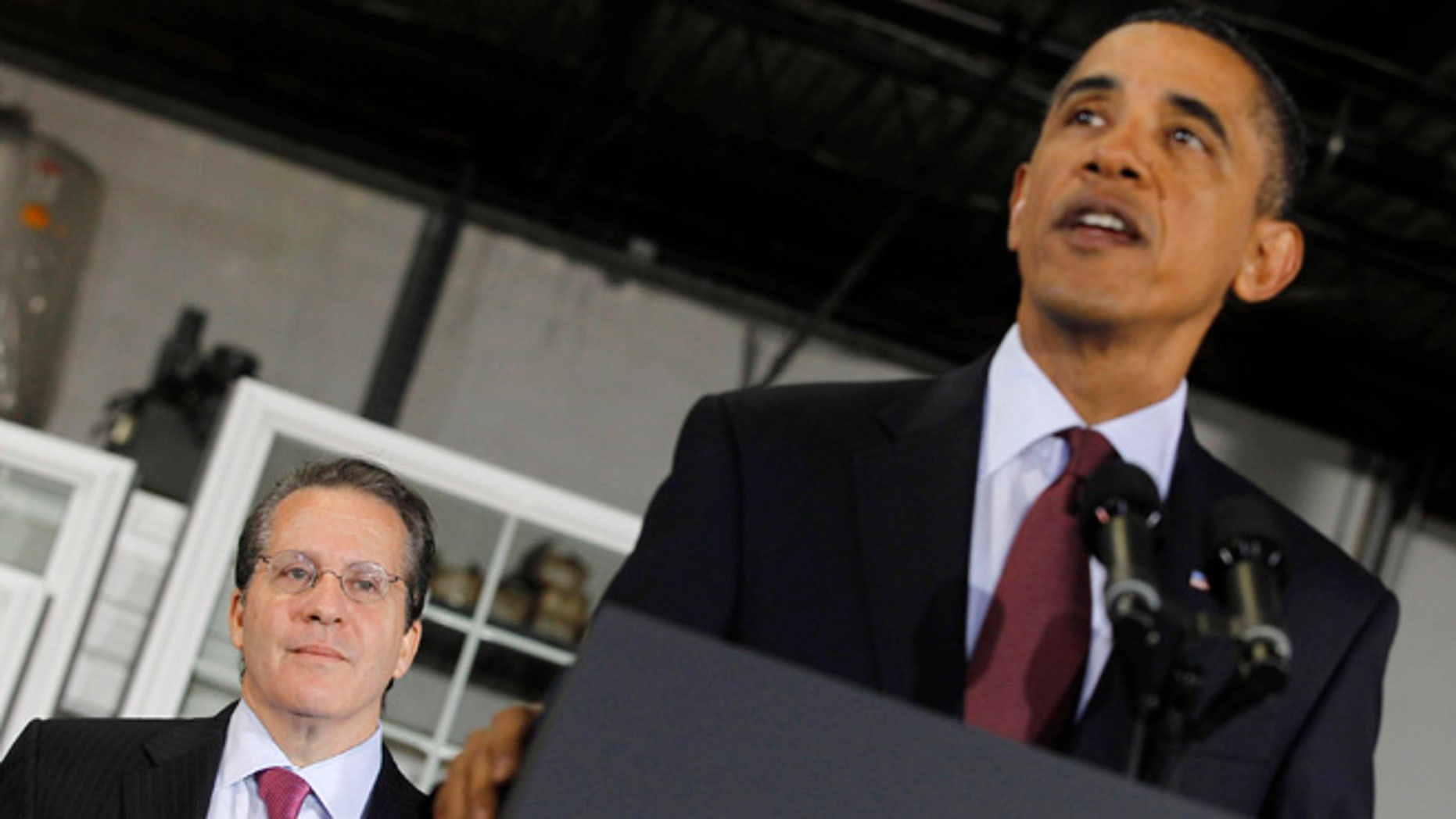 In this Jan. 7, 2011, file photo, President Obama discusses the economy alongside National Economic Council head Gene Sperling in Landover, Md.