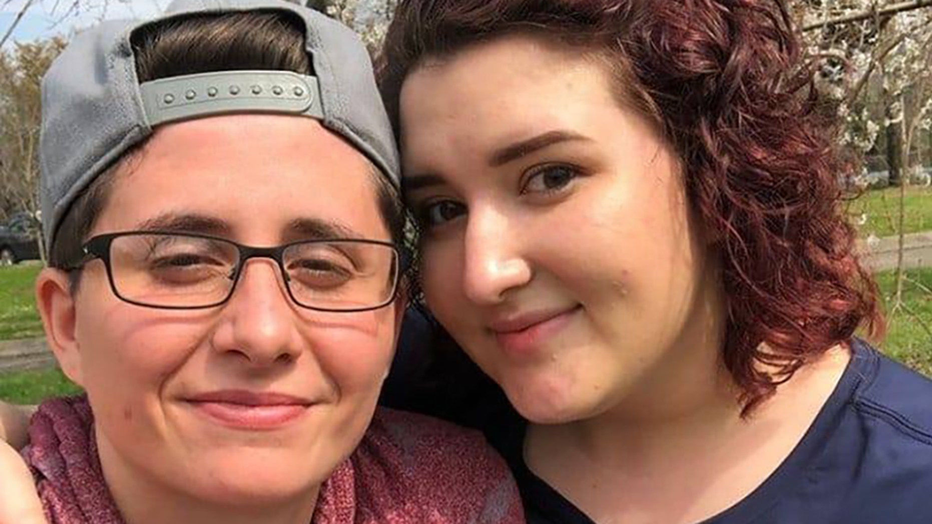 Angela Wright, left, and her fiancee, Victoria Owen, right, are moving out of the apartment sooner than first expected.