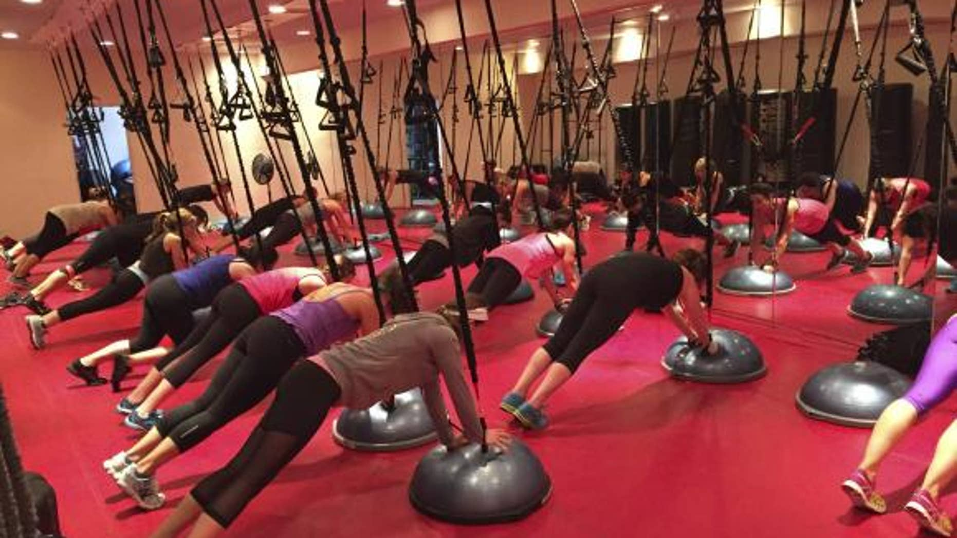Participants work out during a Spiderband fitness class in a handout picture taken at Fuel Fitness in Brooklyn, New York, in October, 2014.