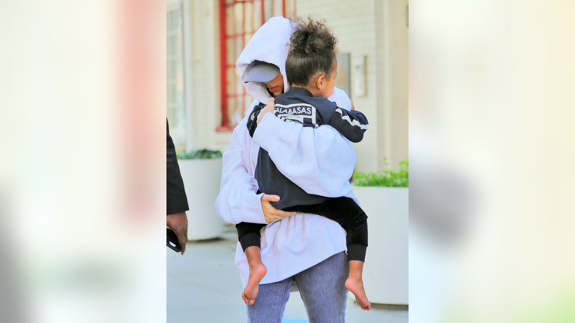 Kim Kardashian runs to her waiting SUV with North West in New York.