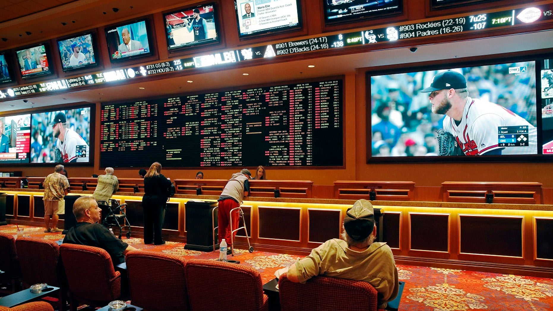 Mississippi gambling regulators approved rules on Thursday to legalize sports betting. Pictured: The South Point hotel and casino sports betting parlor in Las Vegas.