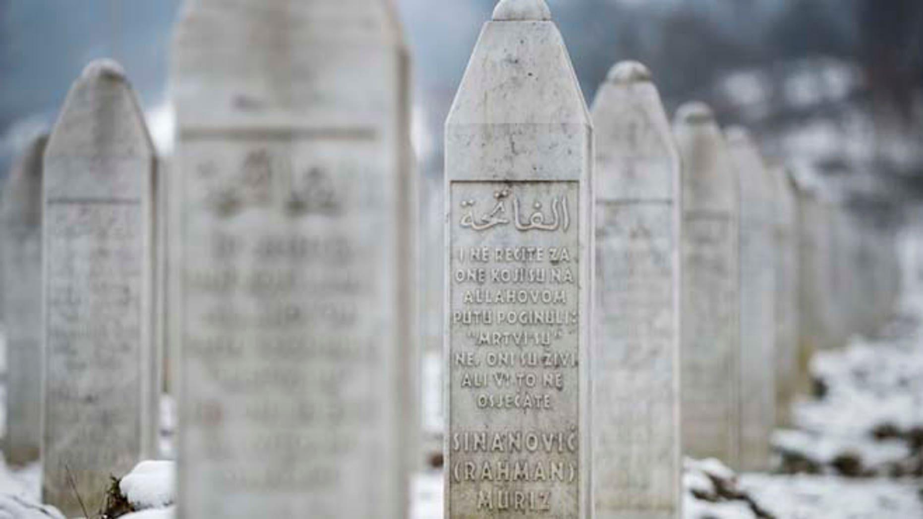 Saturday, March 7, 2015: This photo taken in the memorial cemetery Potocari, outside Srebrenica, shows the gravestone of Muriz Sinanovic. Sinanovic was among the 8,000 Muslim Bosniak men and boys killed in July 1995 Srebrenica massacre.