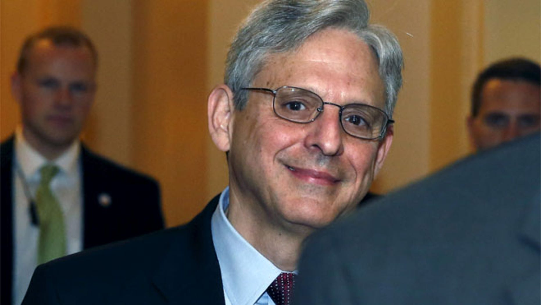 FILE; Judge Merrick Garland walks after a breakfast with Senate Judiciary Committee Chair Senator Chuck Grassley.