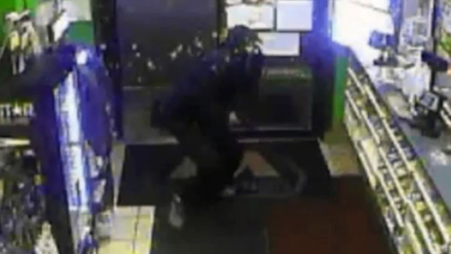 An armed robbery suspect was splashed in the face with hot coffee Sunday at a gas station in Muncie, Ind.