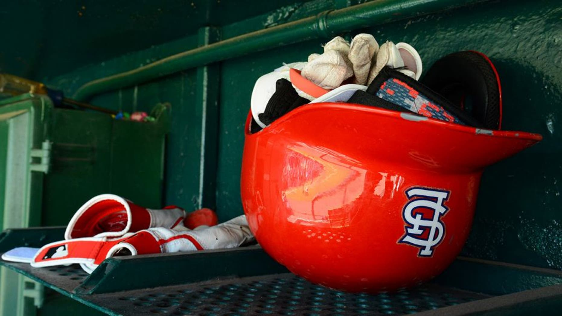 LAKELAND, FL - MARCH 03: A detailed view of a St. Louis Cardinals batting helmet sitting in the dugout prior to the spring training game against the Detroit Tigers at Joker Marchant Stadium on March 3, 2014 in Lakeland, Florida. The Tigers defeated the Cardinals 8-5. (Photo by Mark Cunningham/MLB Photos via Getty Images)