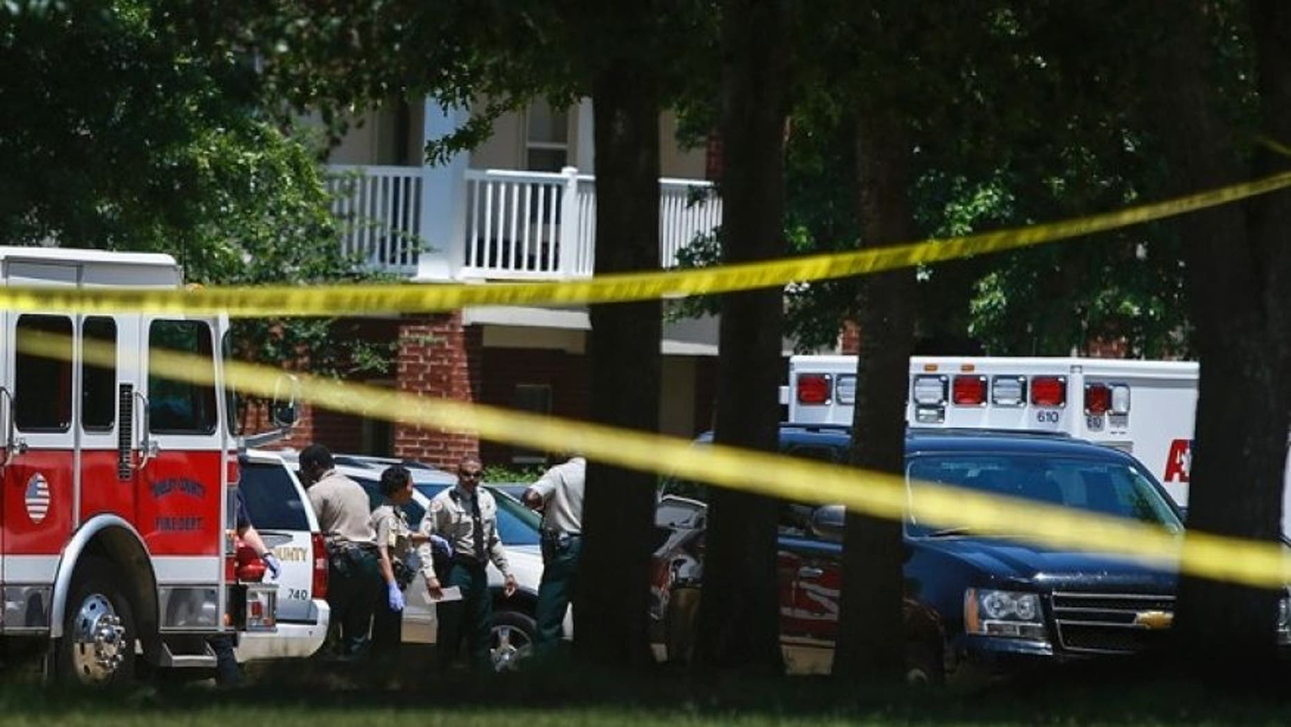 Shelby County Sheriff's deputies work the scene where four young children were fatally stabbed at the Greens of Irene apartment, Friday, July 1, 2016 in Memphis, Tenn.