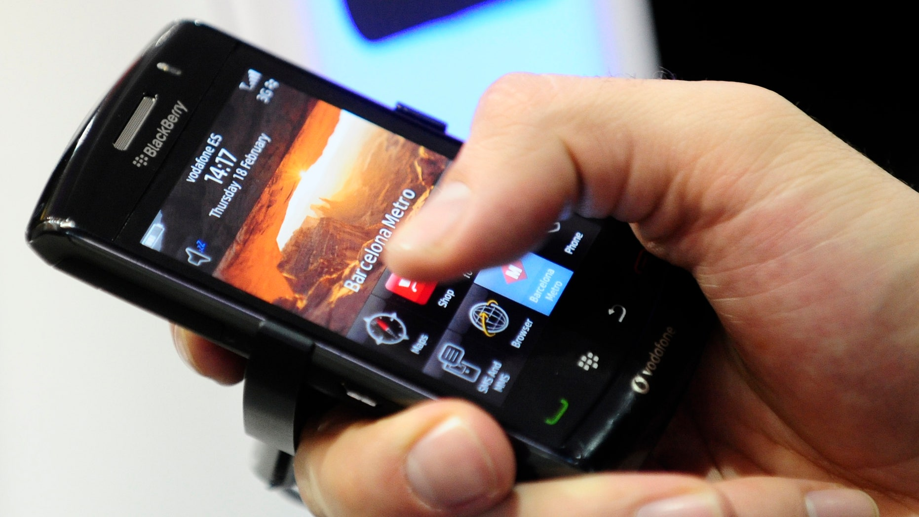 FILE - In this Feb. 18, 2010 file photo, a BlackBerry smart phone is displayed at the Mobile World congress in Barcelona, Spain. The UAE said Sunday, Aug. 1, 2010 it will block key features on BlackBerry smart phones, citing national security concerns because the devices operate beyond the government's ability to monitor their use. Neighboring Saudi Arabia quickly indicated it planned to follow suit. (AP Photo/Manu Fernandez, File)
