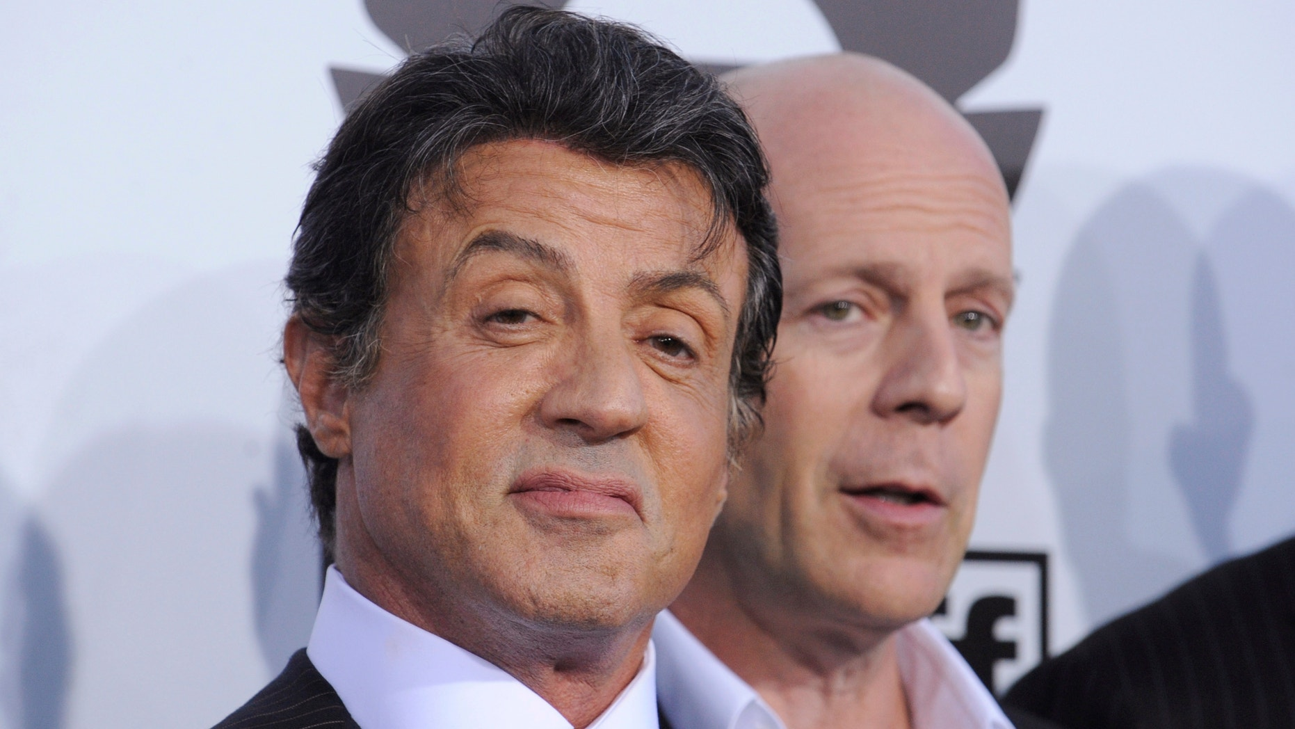 "Cast members Sylvester Stallone (L) and Bruce Willis attend the premiere of the film ""The Expendables"" in Los Angeles August 3, 2010."
