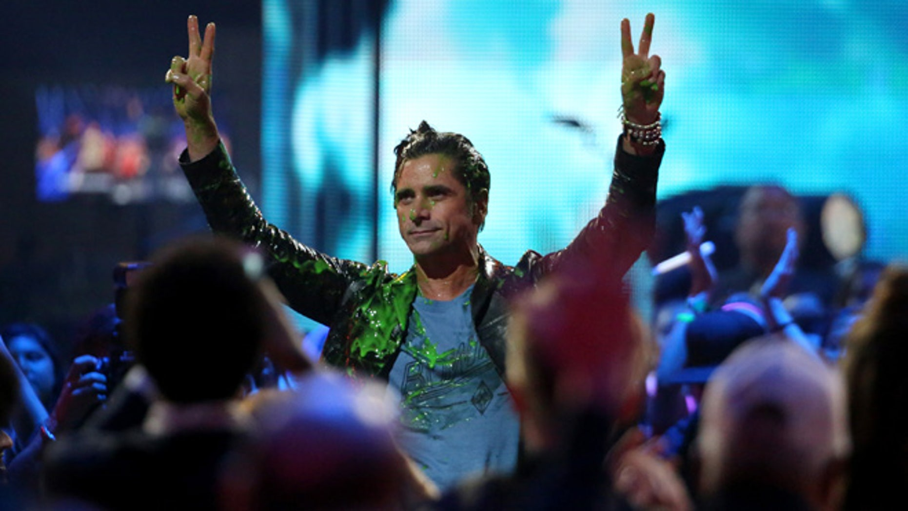 March 12, 2016. John Stamos gets slimed at the Kids' Choice Awards at The Forum on Saturday, March 12, 2016, in Inglewood, Calif.