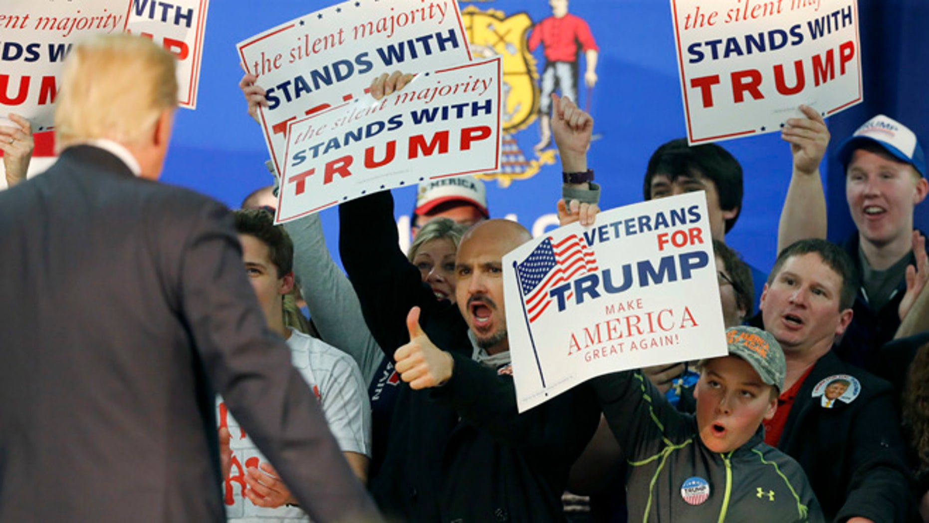 FILE - In this Saturday, April 2, 2016 file photo, a supporter of Republican presidential candidate Donald Trump gives him a thumbs up during a town hall in Rothschild, Wis. (AP Photo/Charles Rex Arbogast, File)