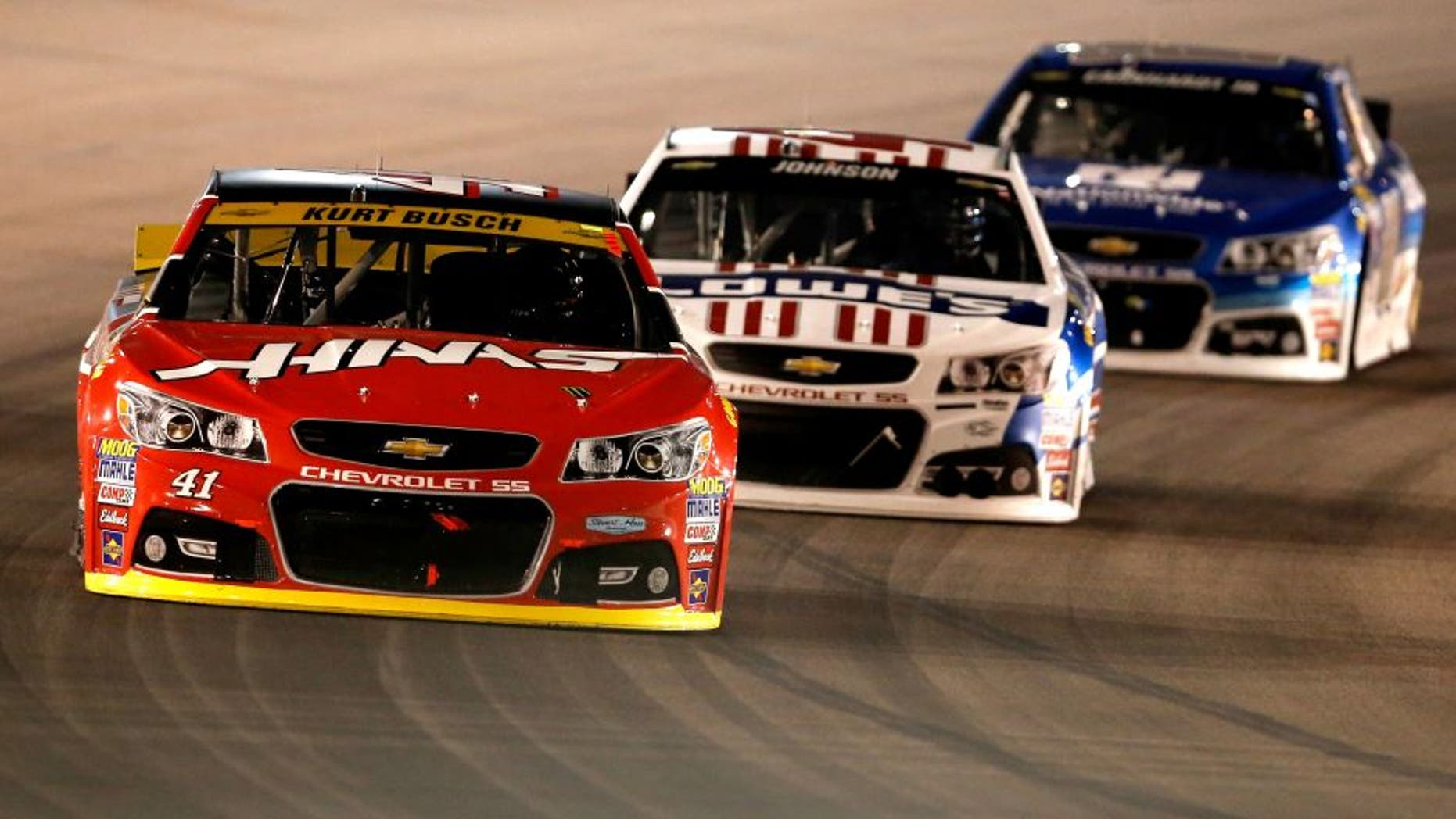 AVONDALE, AZ - NOVEMBER 15: Kurt Busch, driver of the #41 Haas Automation Chevrolet, races Jimmie Johnson, driver of the #48 Lowe's Patriotic Chevrolet, and Dale Earnhardt Jr., driver of the #88 Nationwide Chevrolet, during the NASCAR Sprint Cup Series Quicken Loans Race for Heroes 500 at Phoenix International Raceway on November 15, 2015 in Avondale, Arizona. (Photo by Christian Petersen/Getty Images)