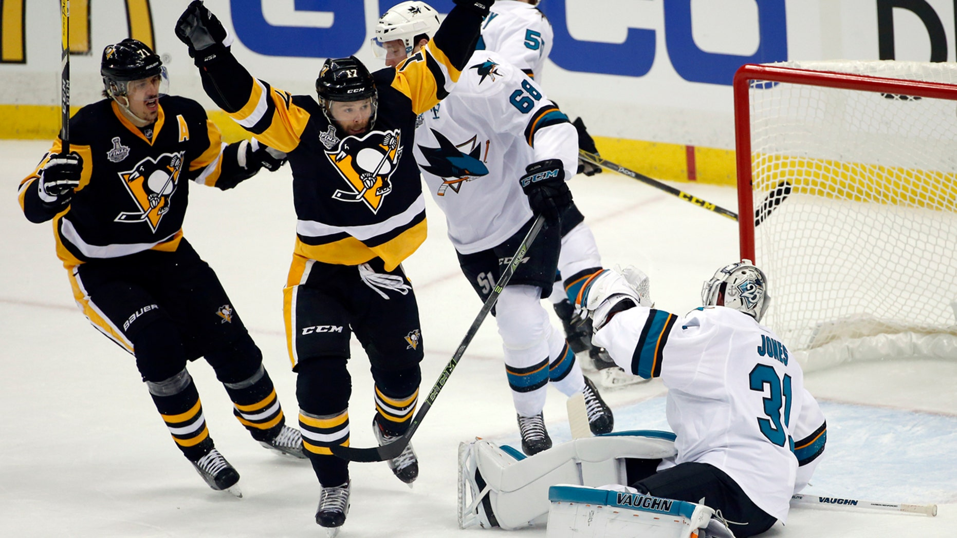 May 30, 2016: Pittsburgh Penguins' Bryan Rust, center, celebrates his goal against San Jose Sharks goalie Martin Jones (31) during the first period in Game 1 of the Stanley Cup final in Pittsburgh.