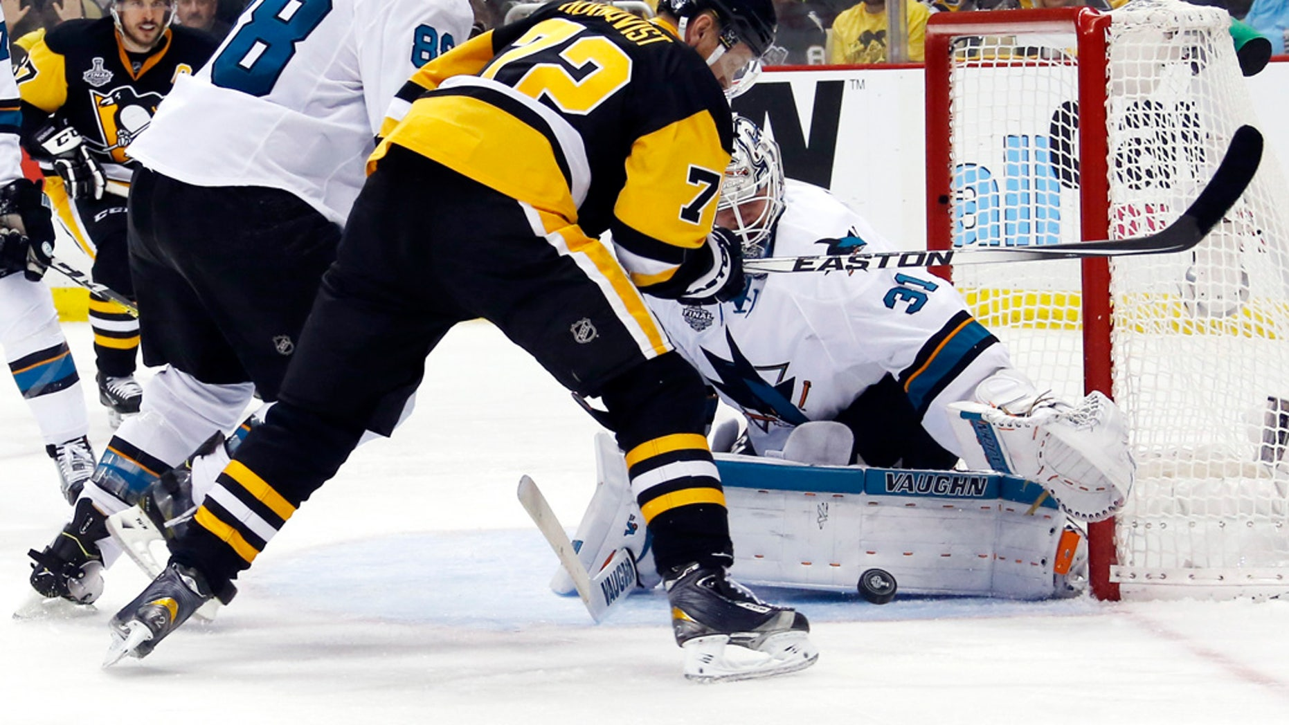 June 9, 2016: San Jose Sharks goalie Martin Jones (31) turns a shot away as Pittsburgh Penguins' Patric Hornqvist (72) and Sharks' Brent Burns (88) scramble in front of the net during the third period in Game 5 of the NHL Stanley Cup Final