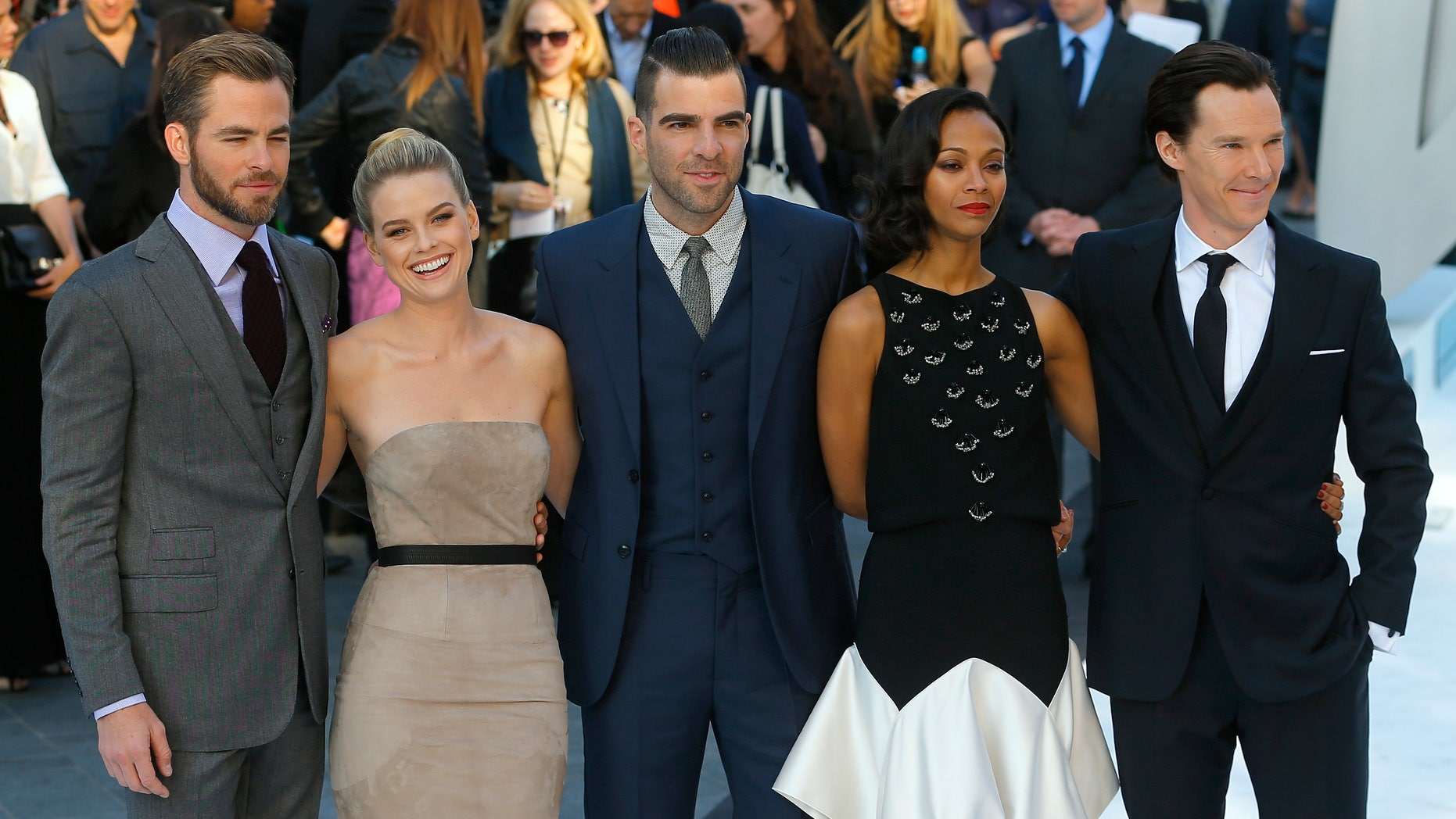 """May 2, 2013. Cast members of """"Star Trek Into Darkness,"""" (L-R) Chris Pine, Alice Eve, Zachary Quinto, Zoe Saldana and Benedict Cumberbatch pose for photographers at the film's international premiere in London."""