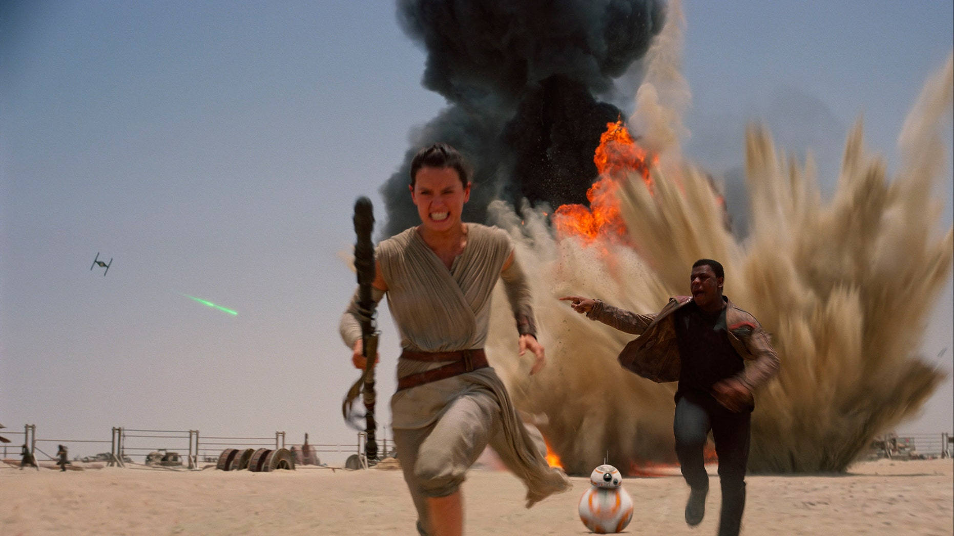 """Daisey Ridley as Rey, left, and John Boyega as Finn, in a scene from the new film, 'Star Wars: Episode VII - The Force Awakens."""""""