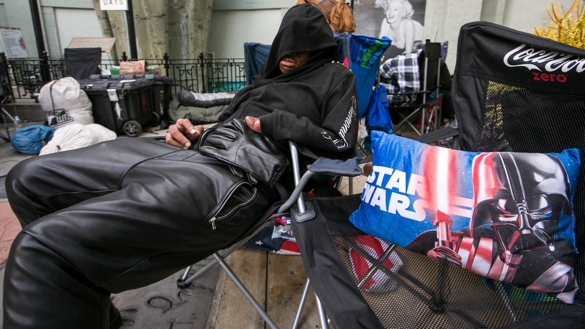 "Dec. 9, 2015 . ""Star Wars"" fan, actor Deuce Wayne, from Virginia, rests outside the TCL Chinese Theater Imax while waiting for the premiere of ""Star Wars: The Force Awakens"" in Los Angeles."