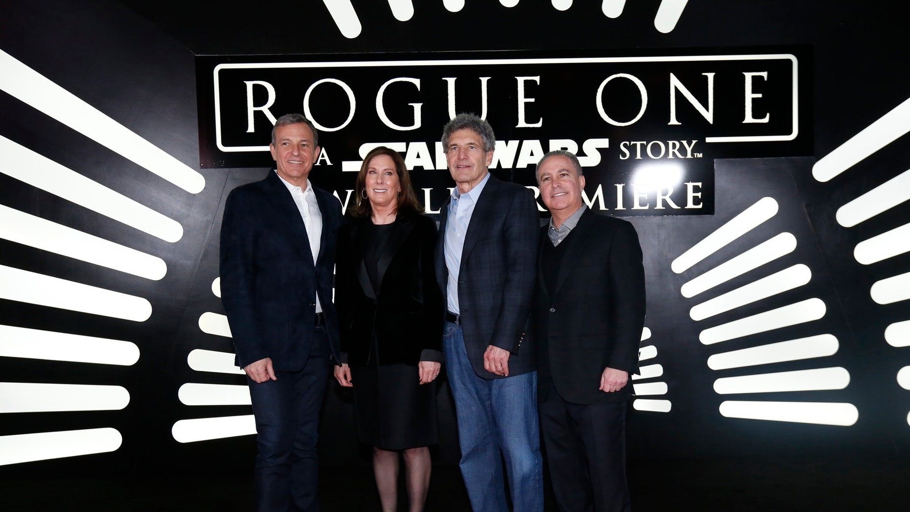 "File photo: Chief Executive Officer of Disney Bob Iger, producer Kathleen Kennedy, Chairman of Walt Disney Studios Alan Horn and President The Walt Disney Studios Alan Bergman (L to R) arrive at the world premiere of the film ""Rogue One: A Star Wars Story"" in Hollywood, California, U.S., December 10, 2016. (REUTERS/Mario Anzuoni)"
