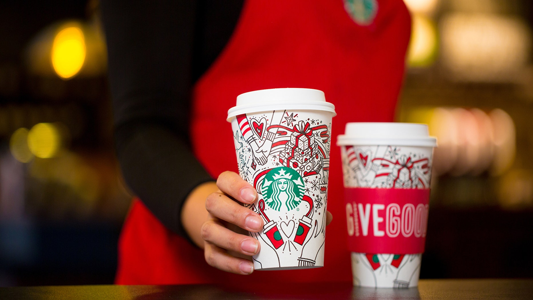 starbucks' new holiday cups feature festive doodles, christmas trees
