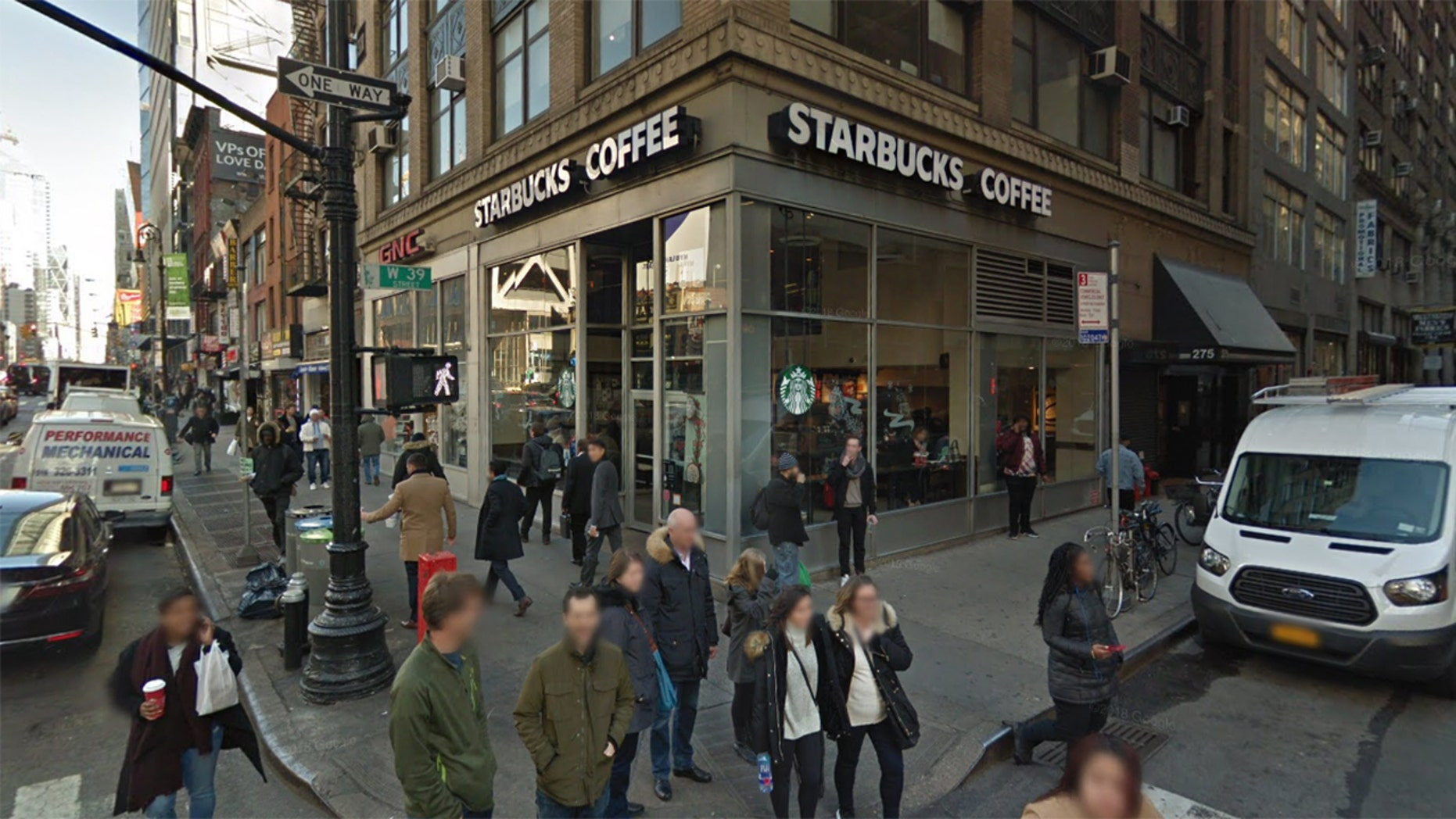 The cop said he warned a Midtown Starbucks to stop giving away free food — and that he suffered an injury when they didn't.