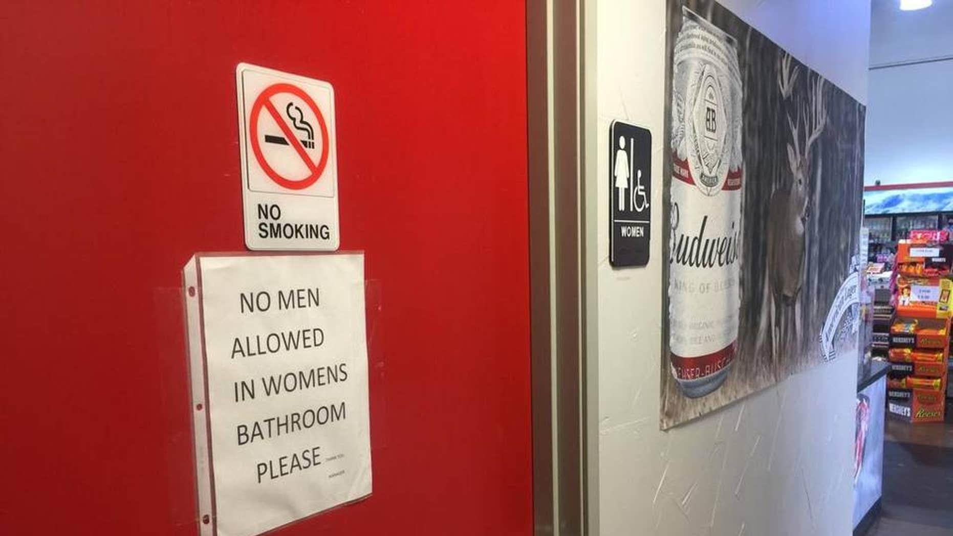 Sign on women's restroom door at BBQ on the Brazos restaurant in Texas.