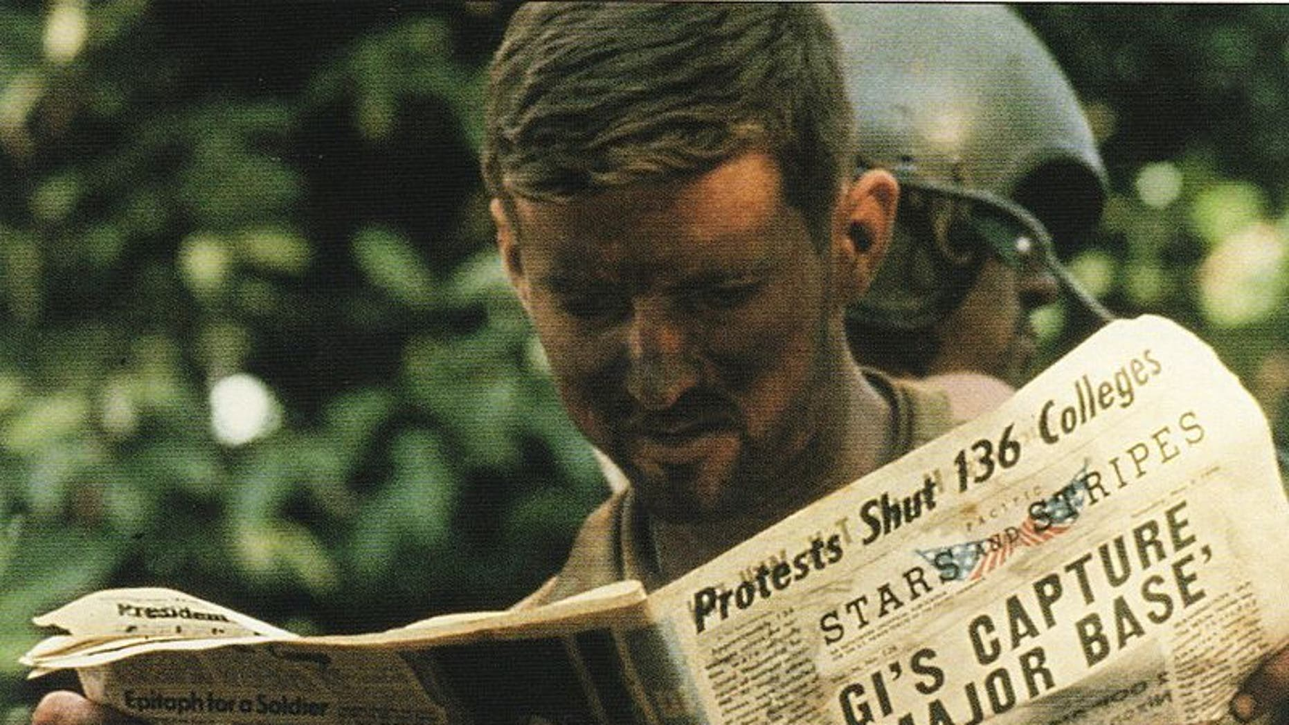 An American soldier reads a copy of Stars and Stripes during the Cambodian Campaign in 1970. (U.S. Army Center of Military History)