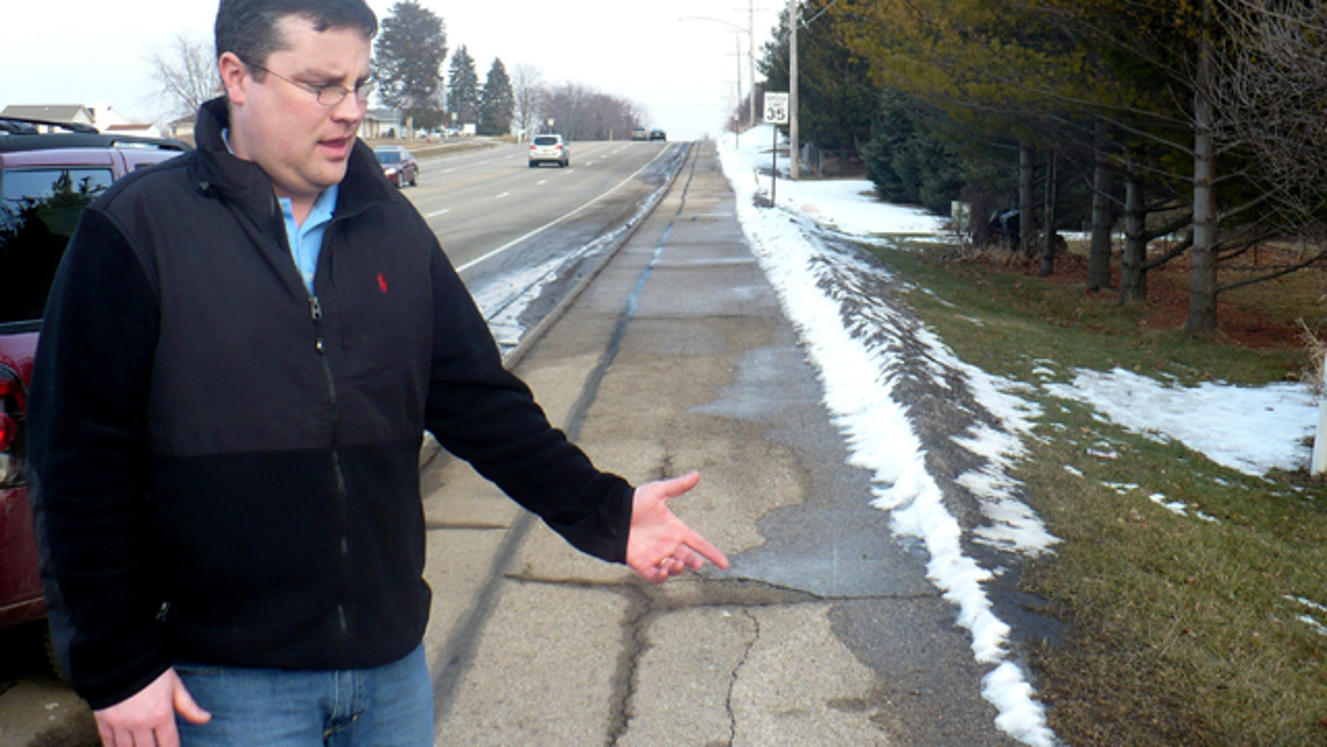 Feb. 15: Mike Vega points to the area of sidewalk where he discovered a starving 15-year-old after she escaped from her abusive father and stepmother last week.