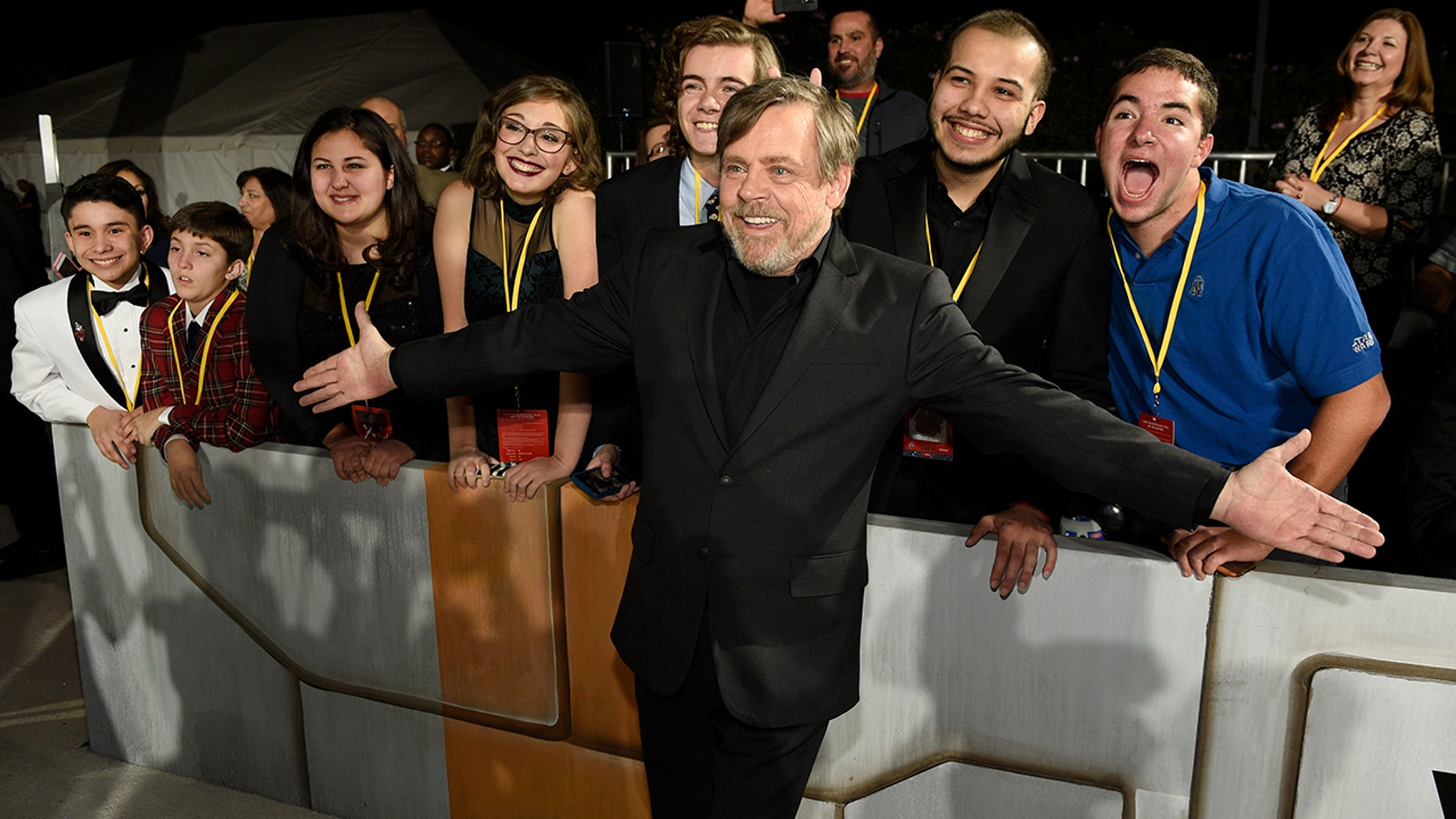 """""""Star Wars: The Last Jedi"""" cast member Mark Hamill poses with special guests at the premiere as part of the Make-A-Wish Foundation."""
