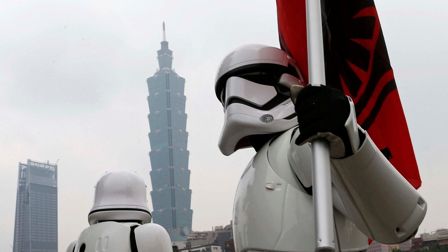 "File photo - Fans dressed as Storm Trooper from ""Star Wars"" pose in front of landmark building Taipei 101 during Star Wars Day in Taipei, Taiwan May 4, 2017. (REUTERS/Tyrone Siu)"