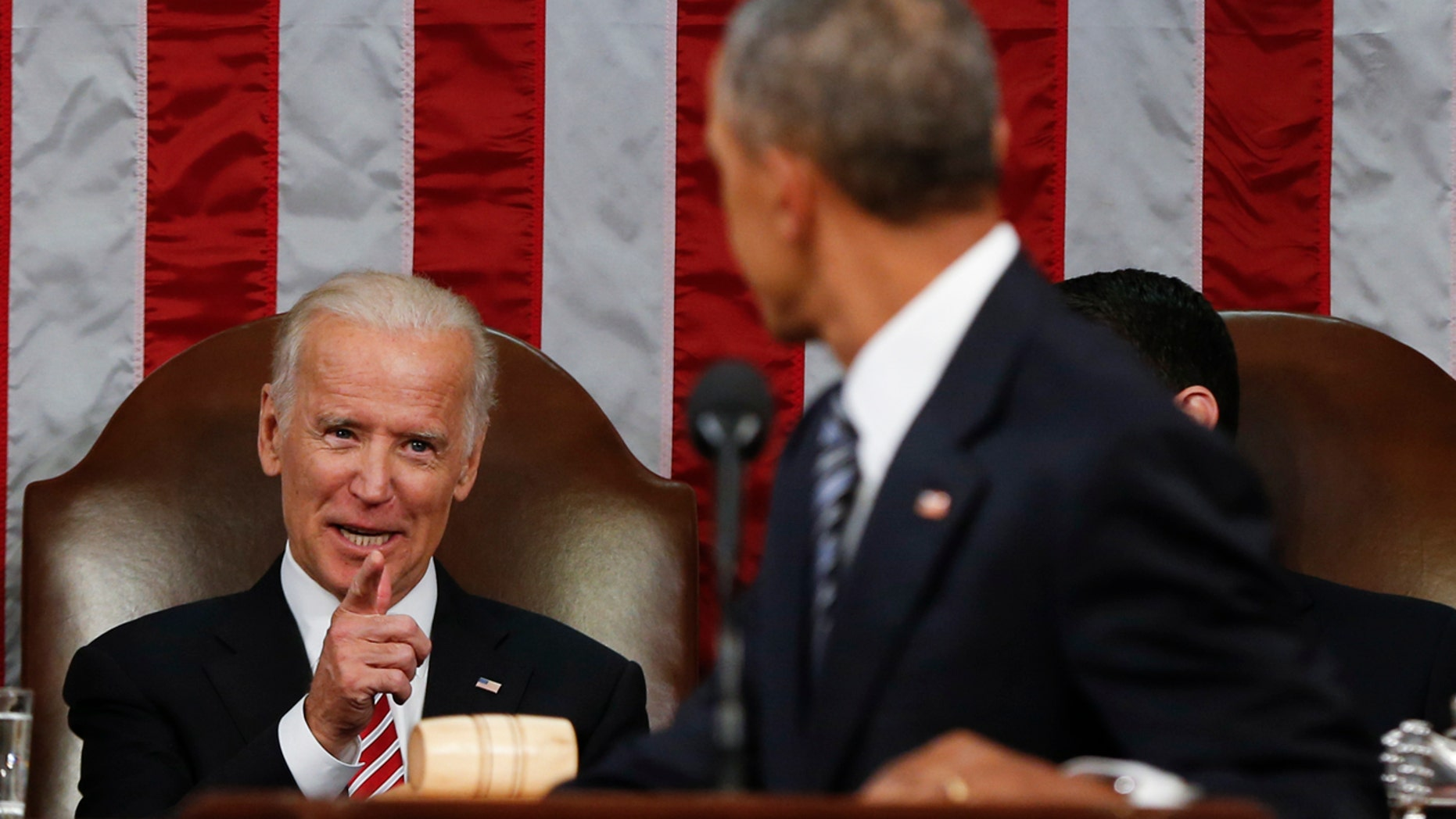 Jan. 12, 2016: Vice President Joe Biden points at President Barack Obama during the State of the Union address to a joint session of Congress on Capitol Hill in Washington. (AP Photo/Evan Vucci, Pool)