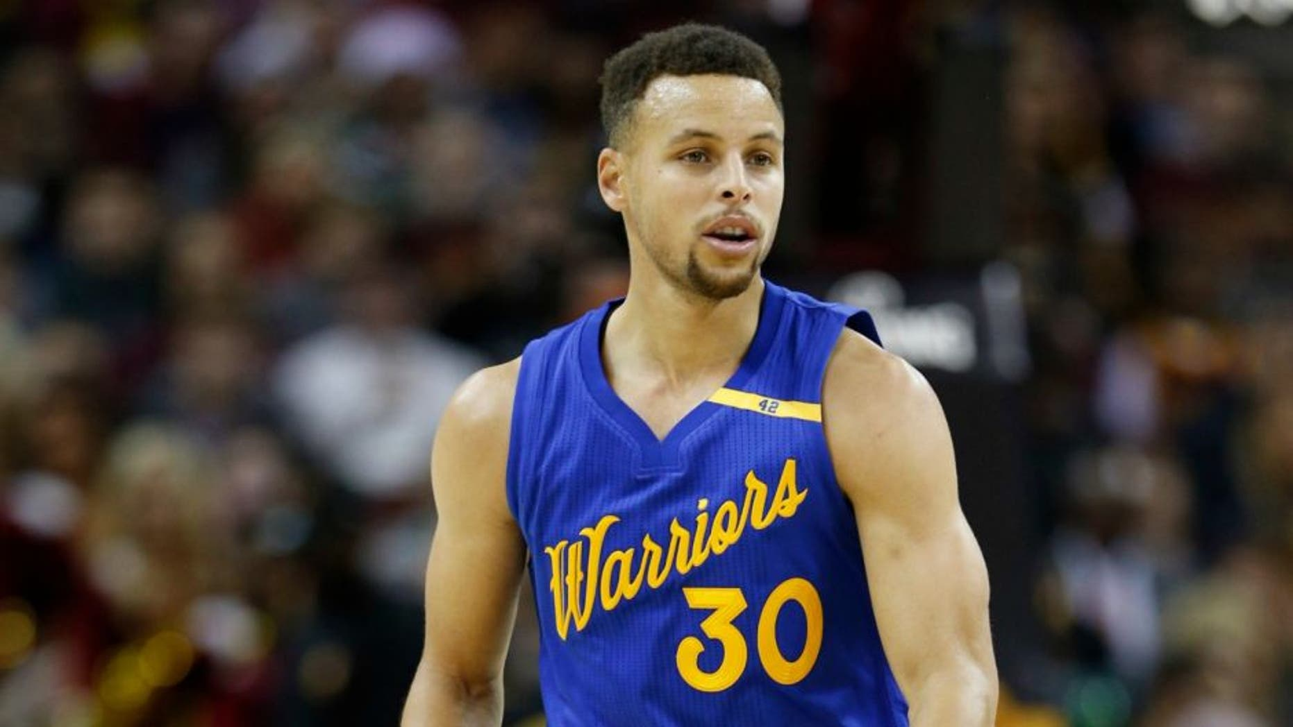 Dec 25, 2016; Cleveland, OH, USA; Golden State Warriors guard Stephen Curry (30) brings the ball up court against the Cleveland Cavaliers at Quicken Loans Arena. Cleveland defeats Golden State 109-108. Mandatory Credit: Brian Spurlock-USA TODAY Sports