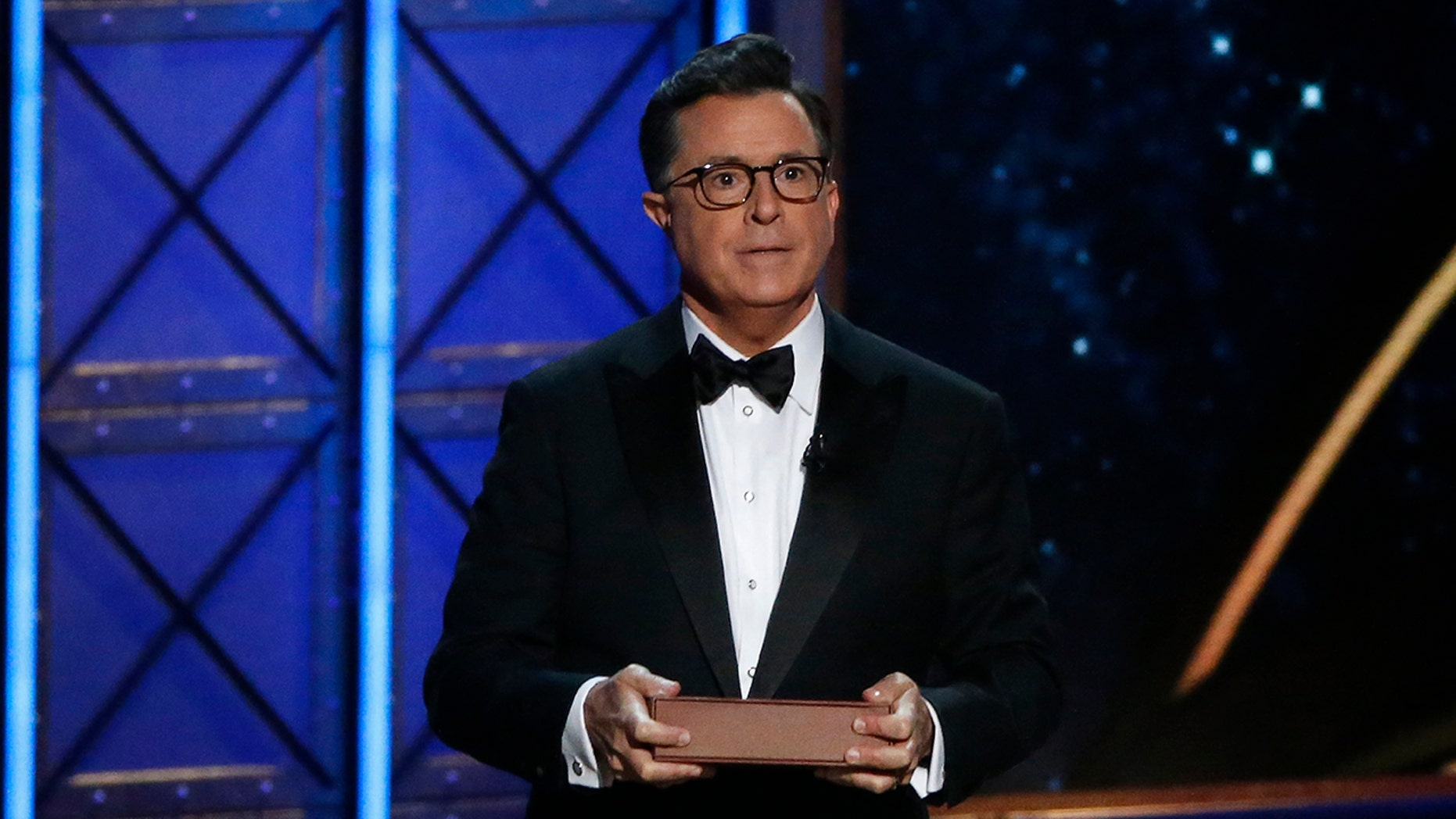 The 69th Primetime Emmy Awards Show in Los Angeles, California, Sept. 17, 2017. Host Stephen Colbert holds a book as he speaks during the show. He'll be vying for another set of media awards this year, #TheFakies Awards.
