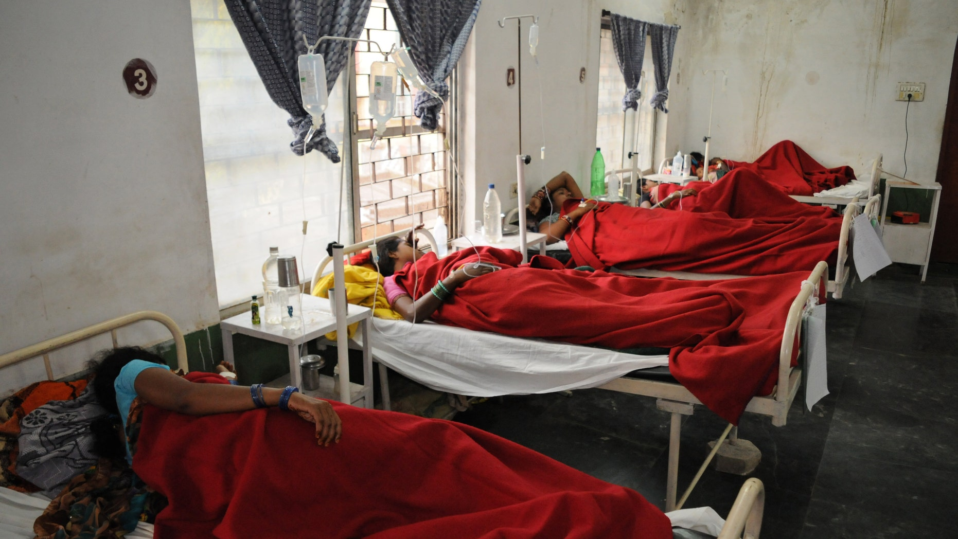 Nov. 12, 2014: Indian women who underwent sterilization surgeries receive treatment at the District Hospital in Bilaspur, in the central Indian state of Chhattisgarh after at least a dozen died and many others fell ill following similar surgery.