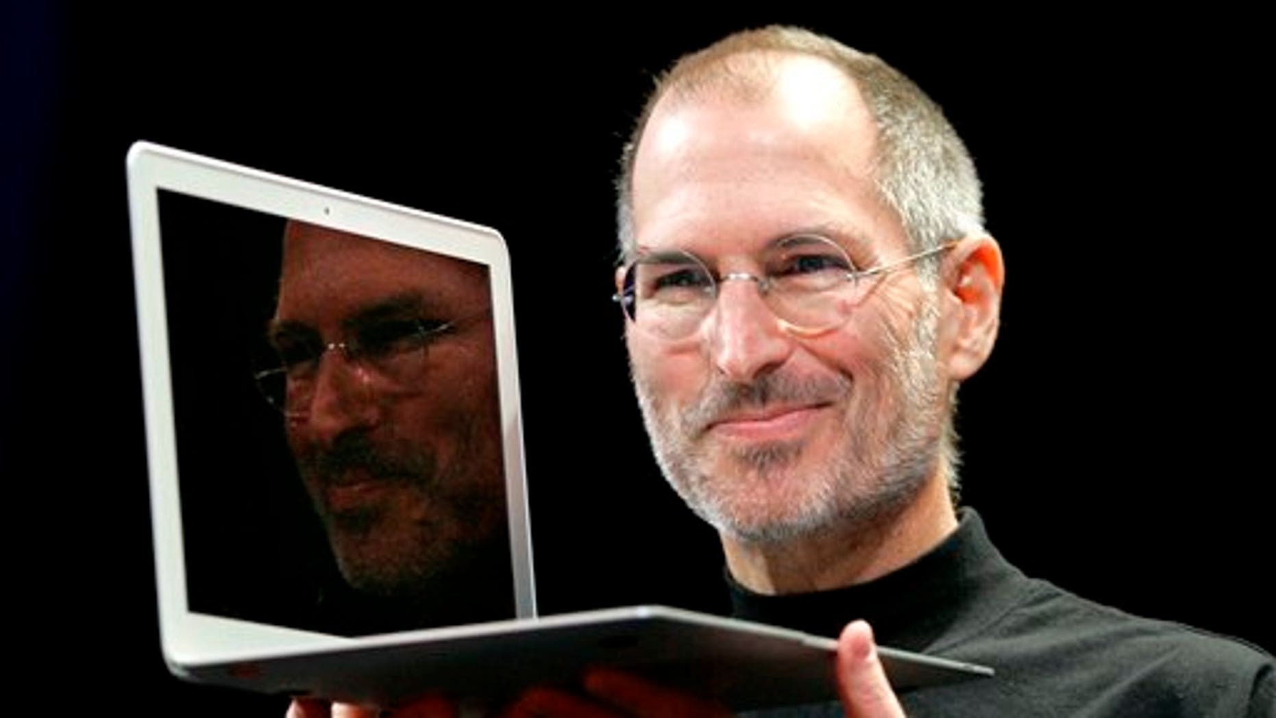 FILE - In this Jan. 15, 2008, file photo, Apple CEO Steve Jobs holds up the new MacBook Air after giving the keynote address at the Apple MacWorld Conference in San Francisco. Apple on Wednesday, Oct. 5, 2011 said Jobs has died. He was 56. (AP Photo/Jeff Chiu, File)