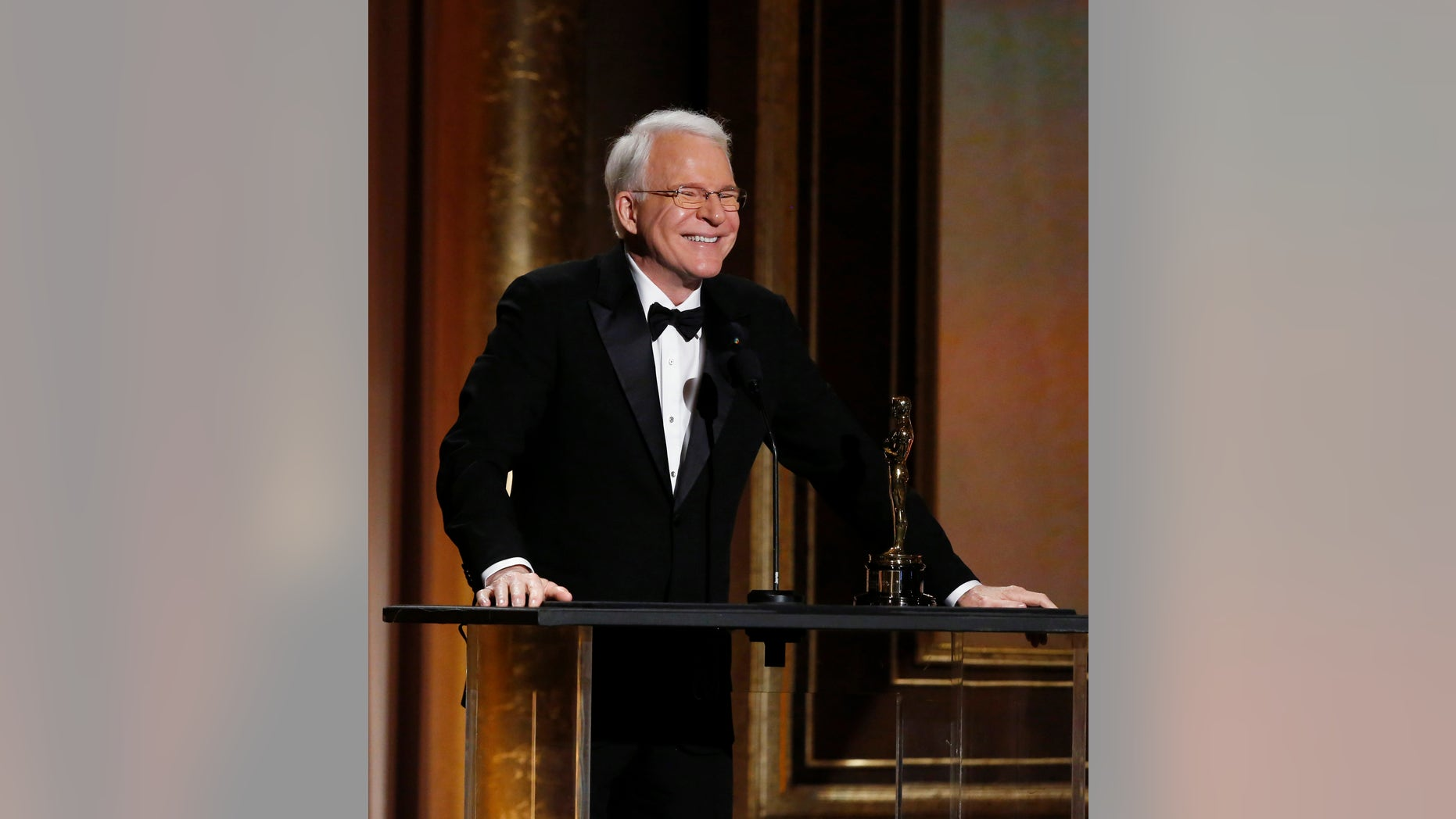 November 16, 2013. Actor Steve Martin smiles as he accepts an Honorary Award at the 5th Annual Academy of Motion Picture Arts and Sciences Governors Awards at The Ray Dolby Ballroom in Hollywood, California.