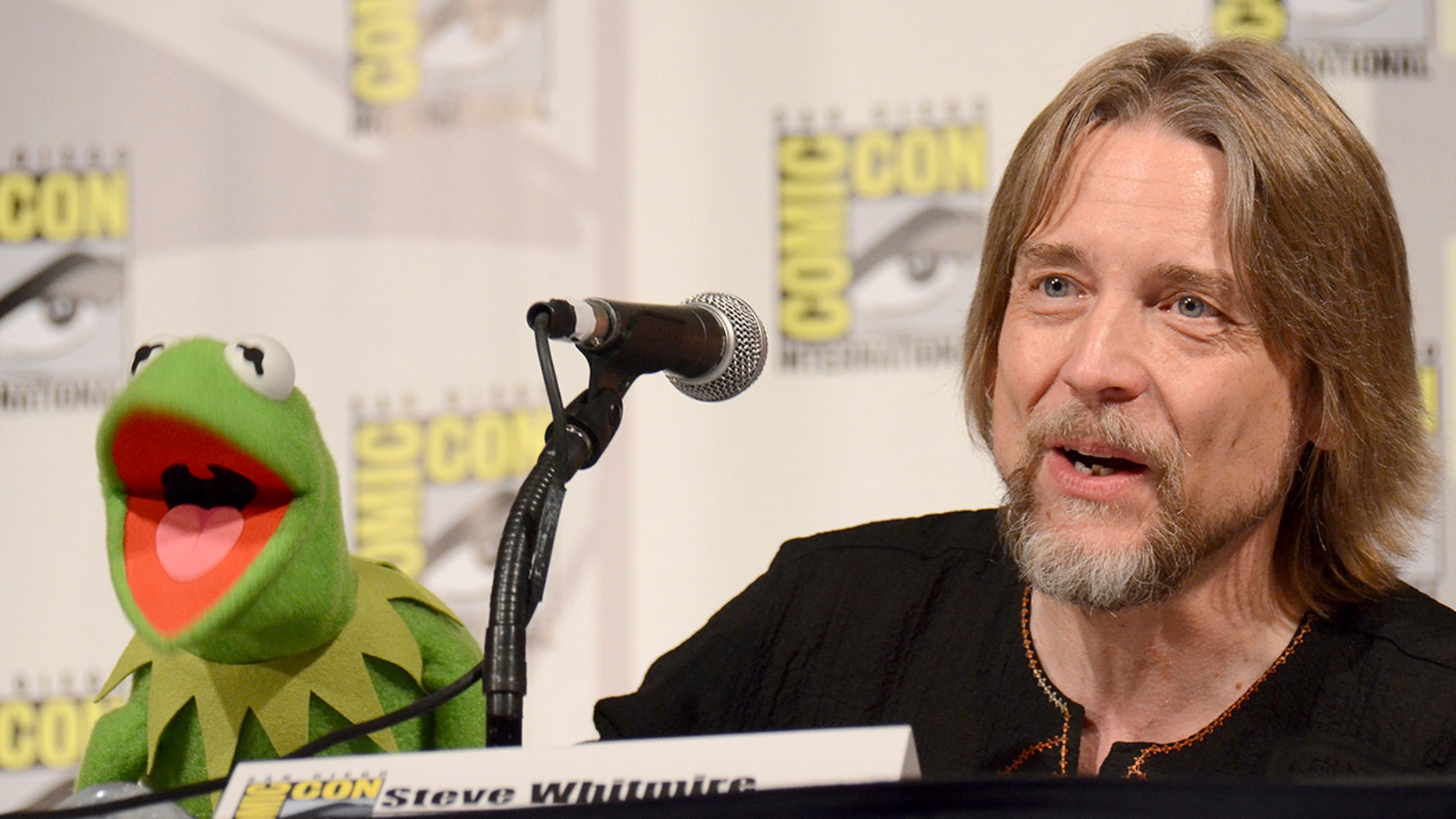 """In this July 11, 2015, file photo, Kermit the Frog, left, and puppeteer Steve Whitmire attend """"The Muppets"""" panel on day 3 of Comic-Con International in San Diego. ABC News and The Hollywood Reporter reported July 10, 2017, that Whitmire is no longer performing the character."""