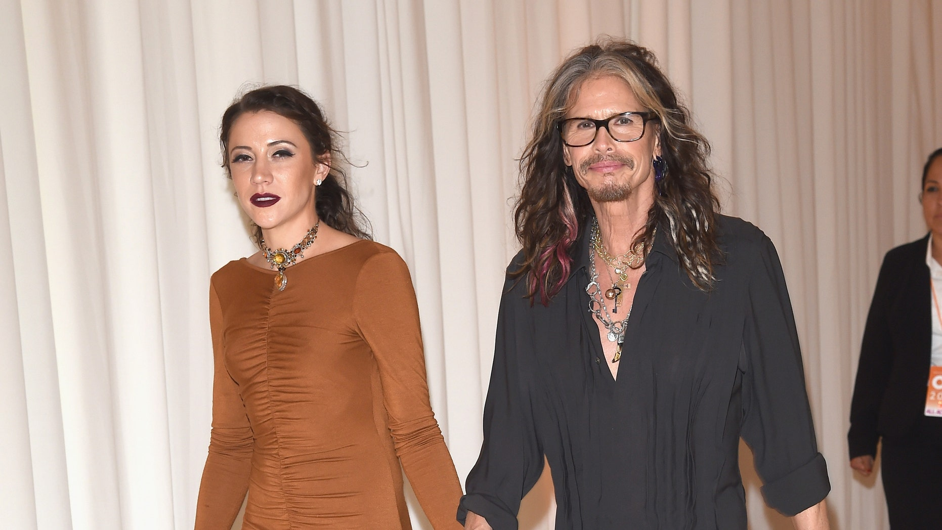 February 28, 2016. Singer Steven Tyler (R) and Aimee Ann Preston attend Bulgari at the 24th Annual Elton John AIDS Foundation's Oscar Viewing Party.