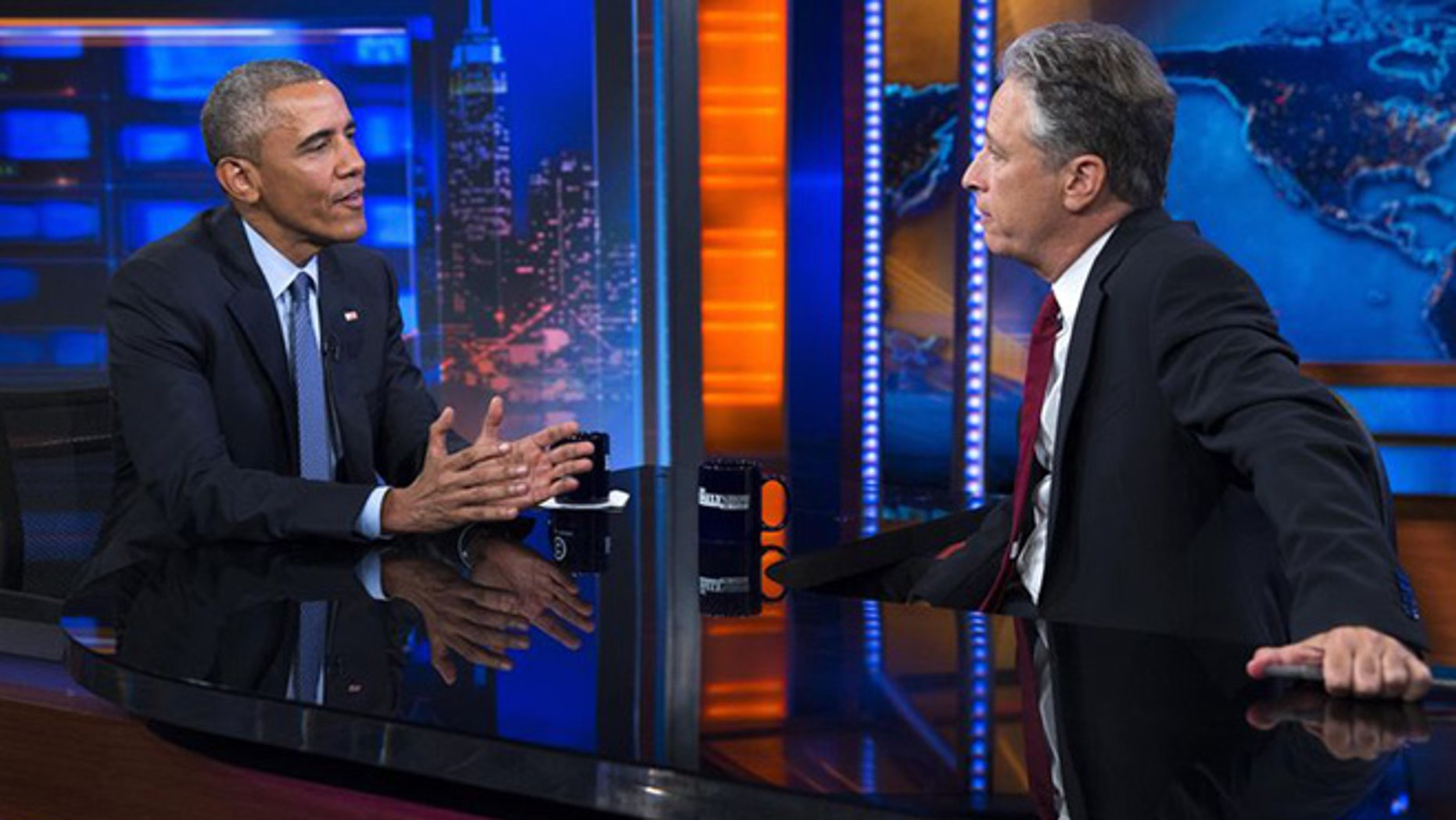 """President Barack Obama, left, talks with Jon Stewart, host of """"The Daily Show"""" during a taping, on Tuesday, July 21, 2015, in New York."""