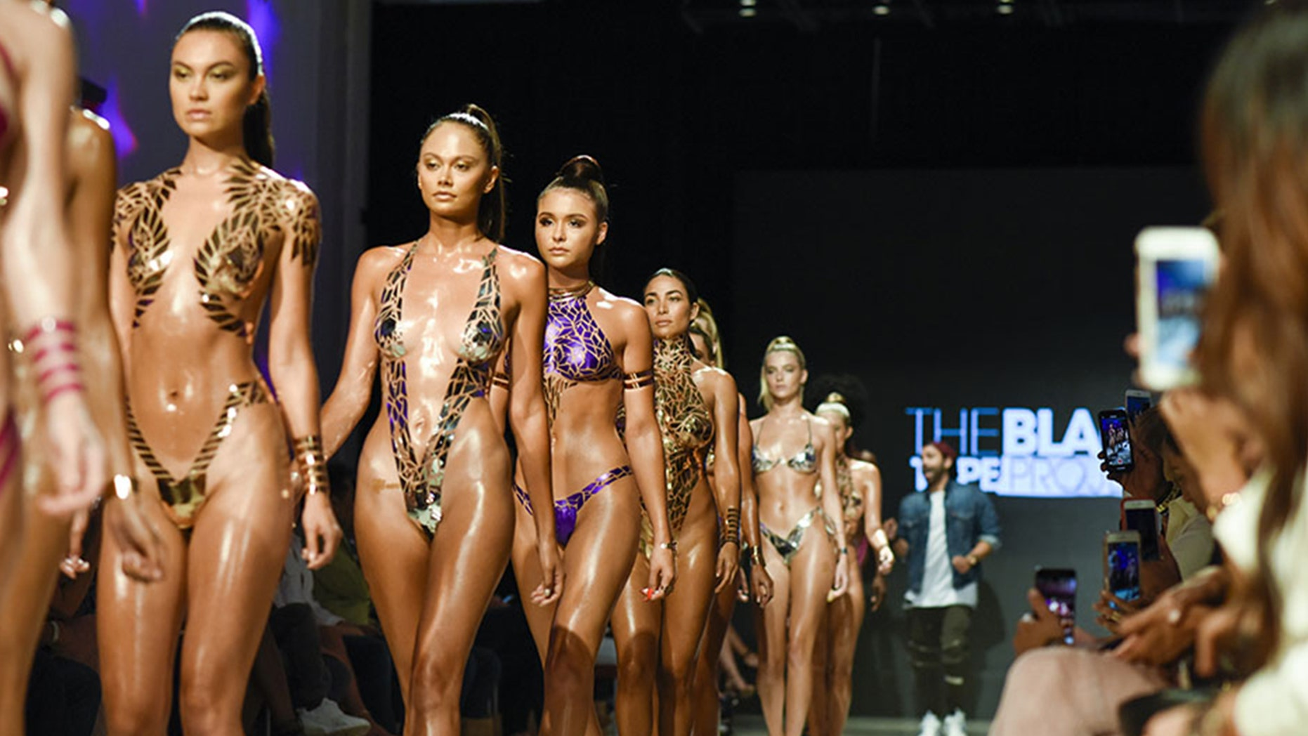 Models walked the runway at Miami Swim Week wearing stick-on swimwear.