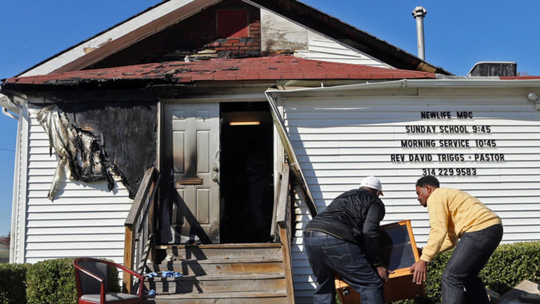 Damage to the New Life Missionary Baptist Church in St. Louis after a fire. (J.B. Forbes/St. Louis Post-Dispatch via AP)