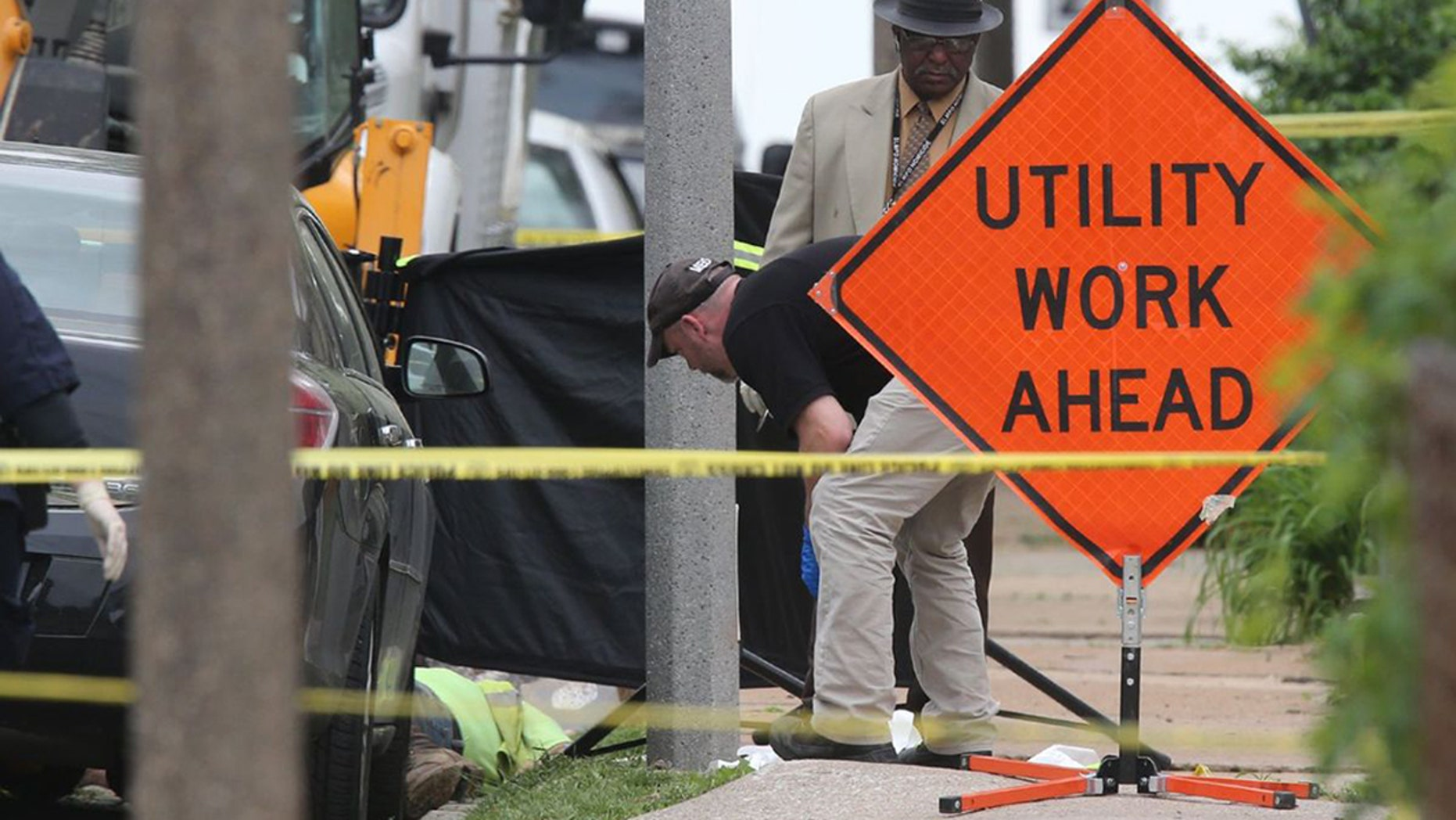 Police investigate a triple shooting in which two Laclede Gas workers were shot and killed in St. Louis on Thursday, April 20, 2017. Police say the shooter also shot and killed himself.