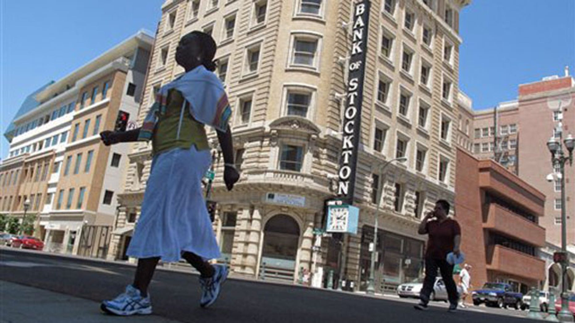 June 27, 2012: Pedestrians cross a street near the Bank of Stockton in Stockton, Calif.