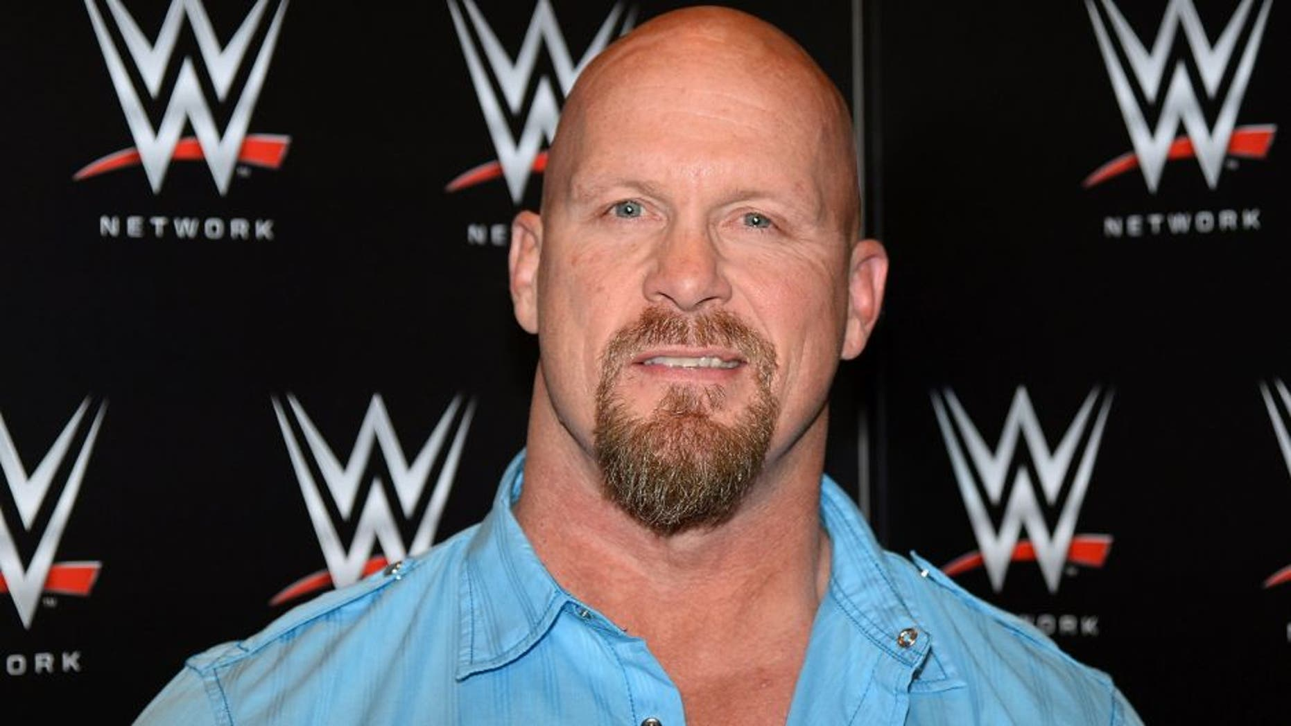 """LAS VEGAS, NV - JANUARY 08: Actor and WWE personality """"Stone Cold"""" Steve Austin appears at a news conference announcing the WWE Network at the 2014 International CES at the Encore Theater at Wynn Las Vegas on January 8, 2014 in Las Vegas, Nevada. The network will launch on February 24, 2014 as the first-ever 24/7 streaming network, offering both scheduled programs and video on demand. The USD 9.99 per month subscription will include access to all 12 live WWE pay-per-view events each year. CES, the world's largest annual consumer technology trade show, runs through January 10 and is expected to feature 3,200 exhibitors showing off their latest products and services to about 150,000 attendees. (Photo by Ethan Miller/Getty Images)"""