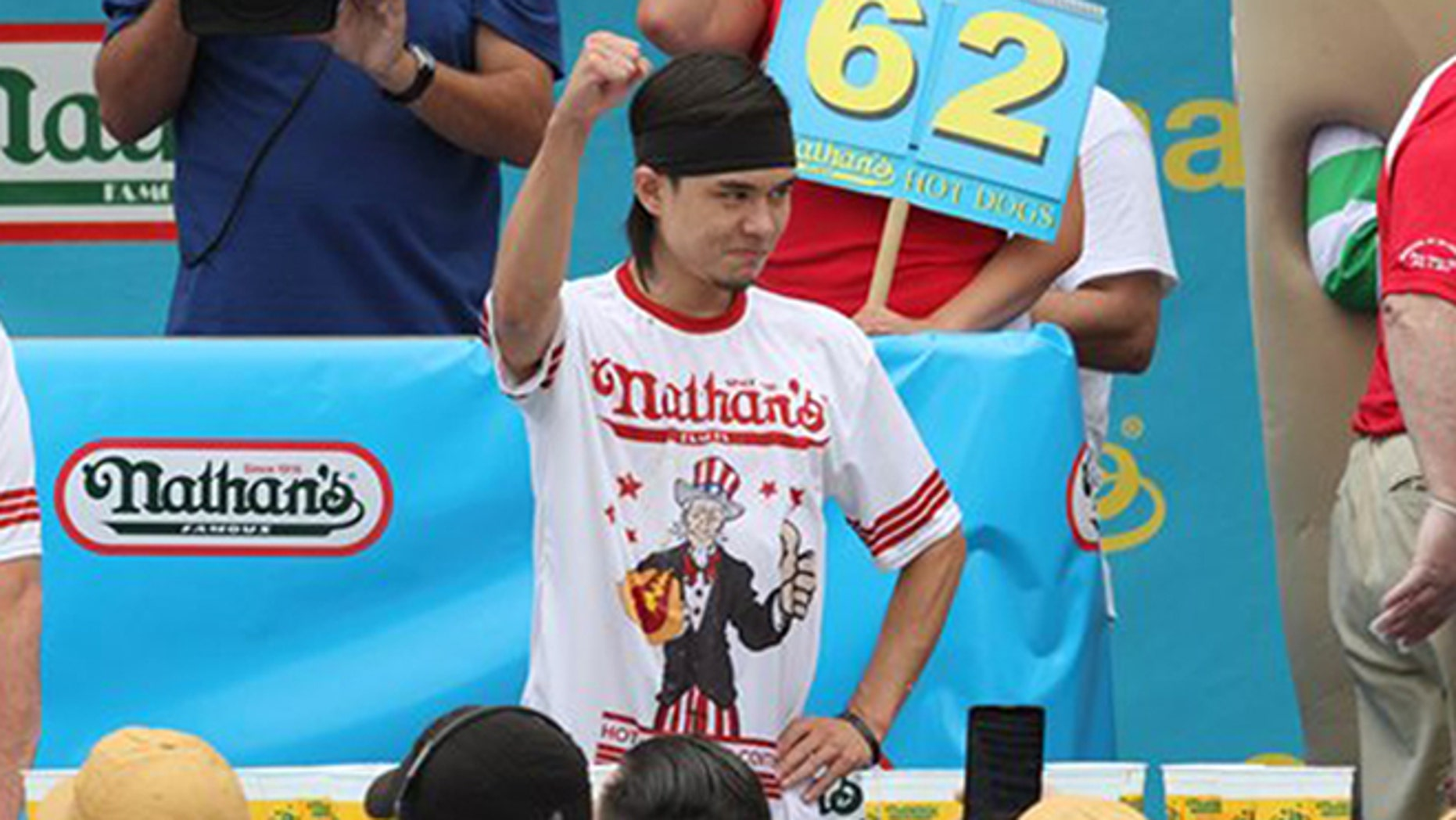 Matt Stonie gestures after winning Nathan's Famous Fourth of July International Hot Dog Eating Contest men's competition Saturday July 4, 2015 in the Coney Island section in the Brooklyn borough of New York. (AP Photo/Tina Fineberg)