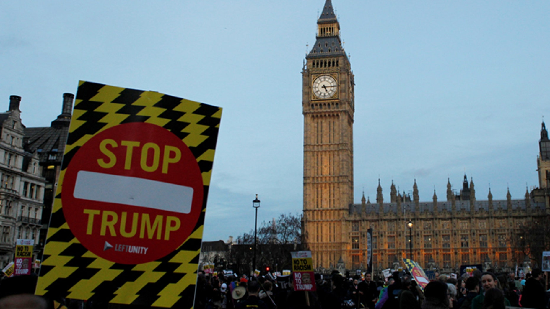 Feb. 20, 2017: A demonstrator holds a placard during a protest against U.S. President Donald Trump in London, Britain.